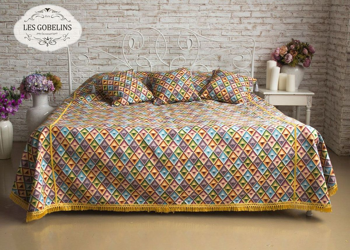 Покрывало на кровать Les Gobelins Kaleidoscope, 240 х 260 смlns183848Покрывало на кровать Les Gobelins Kaleidoscope с ярким геометрическим рисунком привлечет к себе внимание и органично впишется в интерьер комнаты. Изделие изготовлено из высококачественной ткани гобелен и оформлено бахромой и кисточками. Необычайная красота сочетается в этом покрывале с высокой прочностью и долговечностью, а свойство гобелена по-разному проявлять себя в зависимости от освещения помещения позволяет открывать все новые и новые детали, которые, как казалось, раньше скрывал гобелен.Красочное и приятное на ощупь покрывало сделает интерьер спальни, детской или гостиной уютнее и своеобразнее. Состав материала: 50% хлопок, 50% полиэстер.