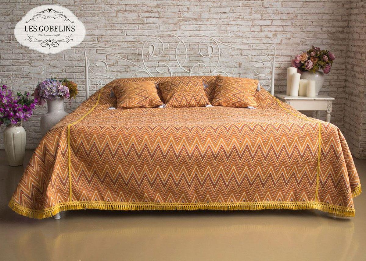 Покрывало на кровать Les Gobelins Zigzag, цвет: коричневый, 260 х 240 смlns184547Покрывало на кровать Les Gobelins Zigzag с ярким геометрическим рисунком привлечет к себе внимание и органично впишется в интерьер комнаты. Изделие изготовлено из высококачественной ткани гобелен и оформлено бахромой и кисточками. Необычайная красота сочетается в этом покрывале с высокой прочностью и долговечностью, а свойство гобелена по-разному проявлять себя в зависимости от освещения помещения позволяет открывать все новые и новые детали, которые, как казалось, раньше скрывал гобелен. Красочное и приятное на ощупь покрывало сделает интерьер спальни, детской или гостиной уютнее и своеобразнее.Состав материала: 52% хлопок, 48% полиэстер.