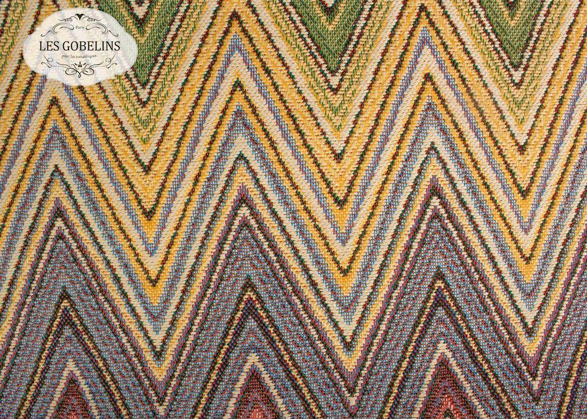 """Покрывало на диван Les Gobelins """"Cordillere"""" с ярким геометрическим рисунком привлечет к себе внимание и органично впишется в интерьер комнаты. Изделие изготовлено из высококачественной ткани гобелен и оформлено бахромой и кисточками. Необычайная красота сочетается в этом покрывале с высокой прочностью и долговечностью, а свойство гобелена по-разному проявлять себя в зависимости от освещения помещения позволяет открывать все новые и новые детали, которые, как казалось, раньше скрывал гобелен. Красочное и приятное на ощупь покрывало сделает интерьер спальни, детской или гостиной уютнее и своеобразнее.  Состав материала:  52% хлопок, 48% полиэстер."""