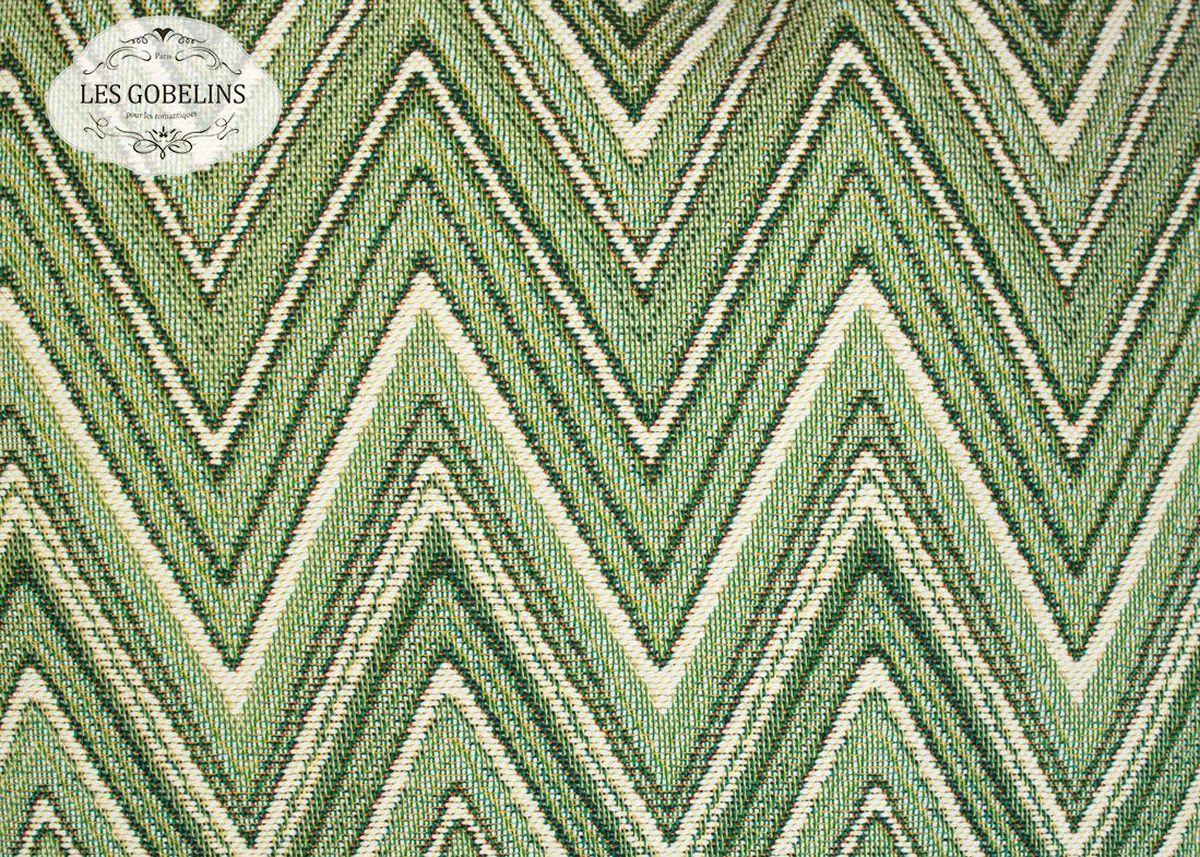 Покрывало на диван Les Gobelins Zigzag, цвет: зеленый, 160 х 230 смlns188452Покрывало на диван Les Gobelins Zigzag с ярким геометрическим рисунком привлечет к себе внимание и органично впишется в интерьер комнаты. Изделие изготовлено из высококачественной ткани гобелен и оформлено бахромой и кисточками. Необычайная красота сочетается в этом покрывале с высокой прочностью и долговечностью, а свойство гобелена по-разному проявлять себя в зависимости от освещения помещения позволяет открывать все новые и новые детали, которые, как казалось, раньше скрывал гобелен.Красочное и приятное на ощупь покрывало сделает интерьер спальни, детской или гостиной уютнее и своеобразнее. Состав материала: 52% хлопок, 48% полиэстер.