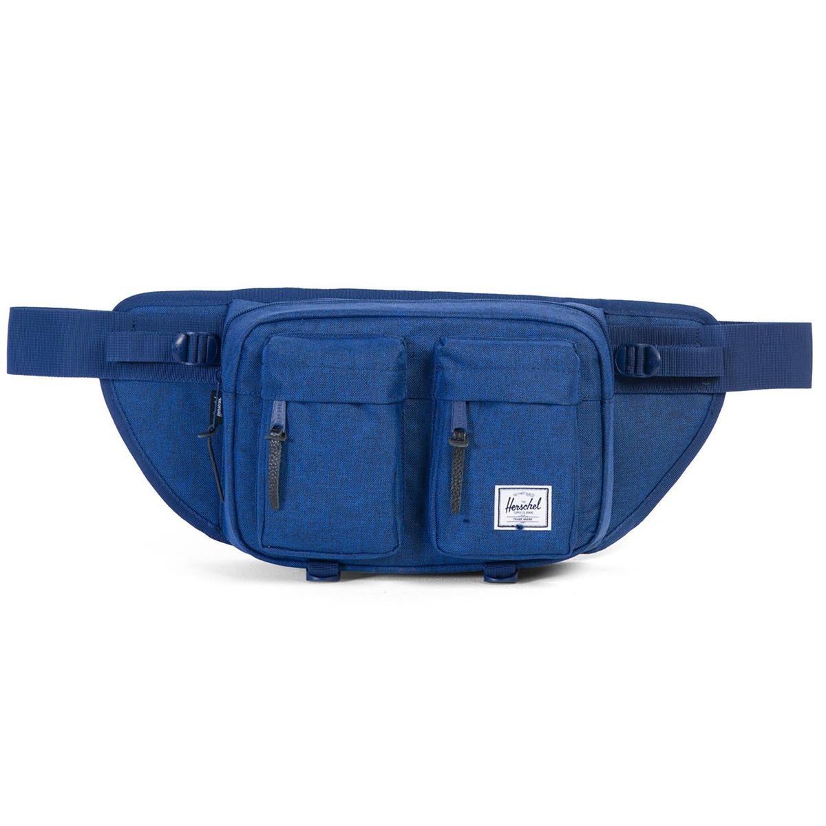 Сумка на пояс Herschel Eighteen (A/S), цвет: темно-синий. 828432124251828432124251Вместительная поясная сумка Herschel Eighteen с двумя внешними карманами. Эта модель отличается своим объемом, за счет которого вы всегда сможете взять собой чуть больше нужных вещей. Удобный поясной ремень позволяет носить сумку также через плечо, что несомненно оценят, например, любители велосипедных прогулок.