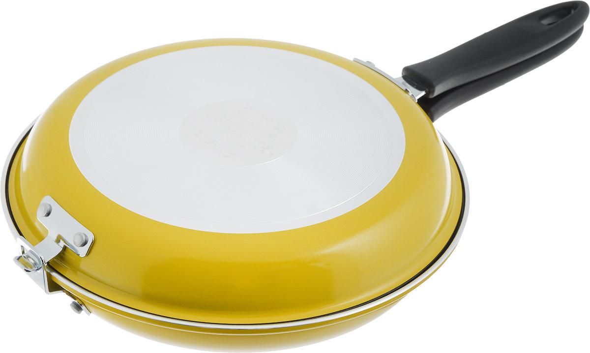 Сковорода двухсторонняя Tescoma Presto, цвет: желтый, стальной. Диаметр 26см. 594346594346_желтыйВысококачественная сковорода Tescoma Presto состоящая из двух частей, изготовлена из высококачественной нержавеющей стали с антипригарным покрытием. Сковорода идеальна для легкой и быстрой двухсторонней жарки и тушения продуктов. Прекрасно подходит для приготовления высоких омлетов типа тортилья, фриттата, фаршированных карманов, овощных и рисовых блюд и так далее. Снабжена ненагревающейся ручкой. Изделие можно использовать как две отдельные классические сковородки.В комплекте предоставлена брошюра с рецептами.Подходит для электрических, газовых и стеклокерамических плит. Можно мыть в посудомоечной машине.Диаметр нижней сковороды: 26 см. Диаметр верхней сковороды: 25 см.