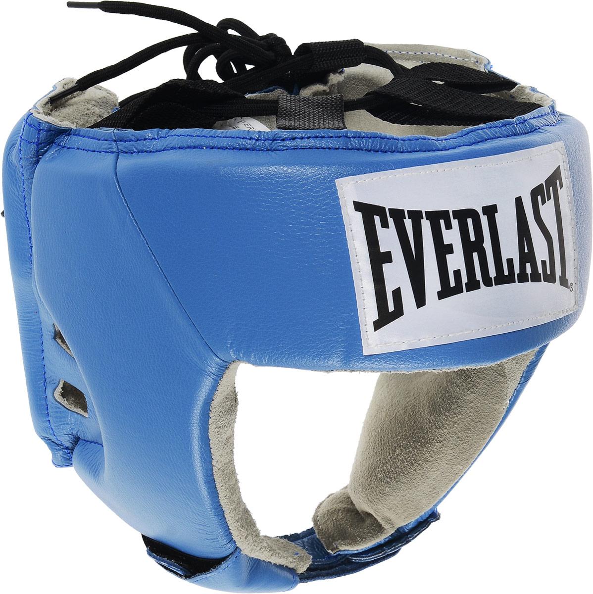 Шлем боксерский Everlast USA Boxing, цвет: синий, белый, черный. Размер XL610600UEverlast USA Boxing - боксерский шлем, разработанный для выступления на любительских соревнованиях и одобренный ассоциацией USA Boxing. Плотный четырехслойный пенный наполнитель превосходно амортизирует удары и значительно снижает риск травмы. Качественная натуральная кожа (снаружи) и не менее качественная замша (внутри) обеспечивают значительный запас прочности и отличную износоустойчивость. Подгонка под необходимый размер и фиксация на голове происходят за счет затягивающихся шнурков. Если вы еще ищите шлем для предстоящих соревнований, то Everlast USA Boxing - это ваш выбор! Диаметр головы: 18 см.