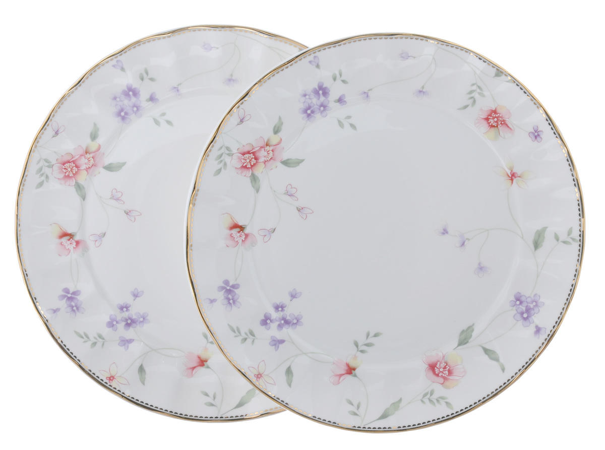 """Набор Colombo """"Флер"""" состоит из двух десертных тарелок, выполненных из высококачественного костяного фарфора. Изделия декорированы изображениями цветов. Тарелки имеют круглую форму, края волнистые. Такой набор украсит сервировку стола и порадует вас изящным дизайном.  Диаметр (по верхнему краю): 20,5 см. Высота: 2 см."""