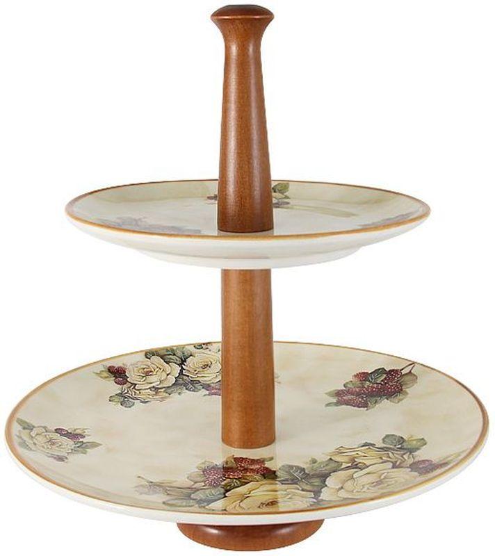 Двухъярусная ваза для фруктов LCS Роза и малина, высота 33 см54161Двухъярусная ваза для фруктов h33см Роза и малинаLCS - молодая, динамично развивающаяся итальянская компания из Флоренции, производящая разнообразную керамическую посуду и изделия для украшения интерьера. В своих дизайнах LCS использует как классические, так и современные тенденции. Высокий стандарт изделий обеспечивается за счет соединения высоко технологичного производства и использования ручной работы профессиональных дизайнеров и художников, работающих на фабрике.