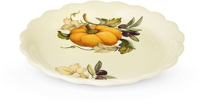 """Закусочная тарелка круглой формы Nuova Cer """"Тыква"""" изготовлена из высококачественной керамики бежевого цвета. Дно оформлено красочным изображением фруктов. Края изделия волнистые. Предназначена для сервировки закусок.  Изящная тарелка прекрасно оформит стол и порадует вас лаконичным и ярким дизайном.  Можно использовать в СВЧ и мыть в посудомоечной машине."""