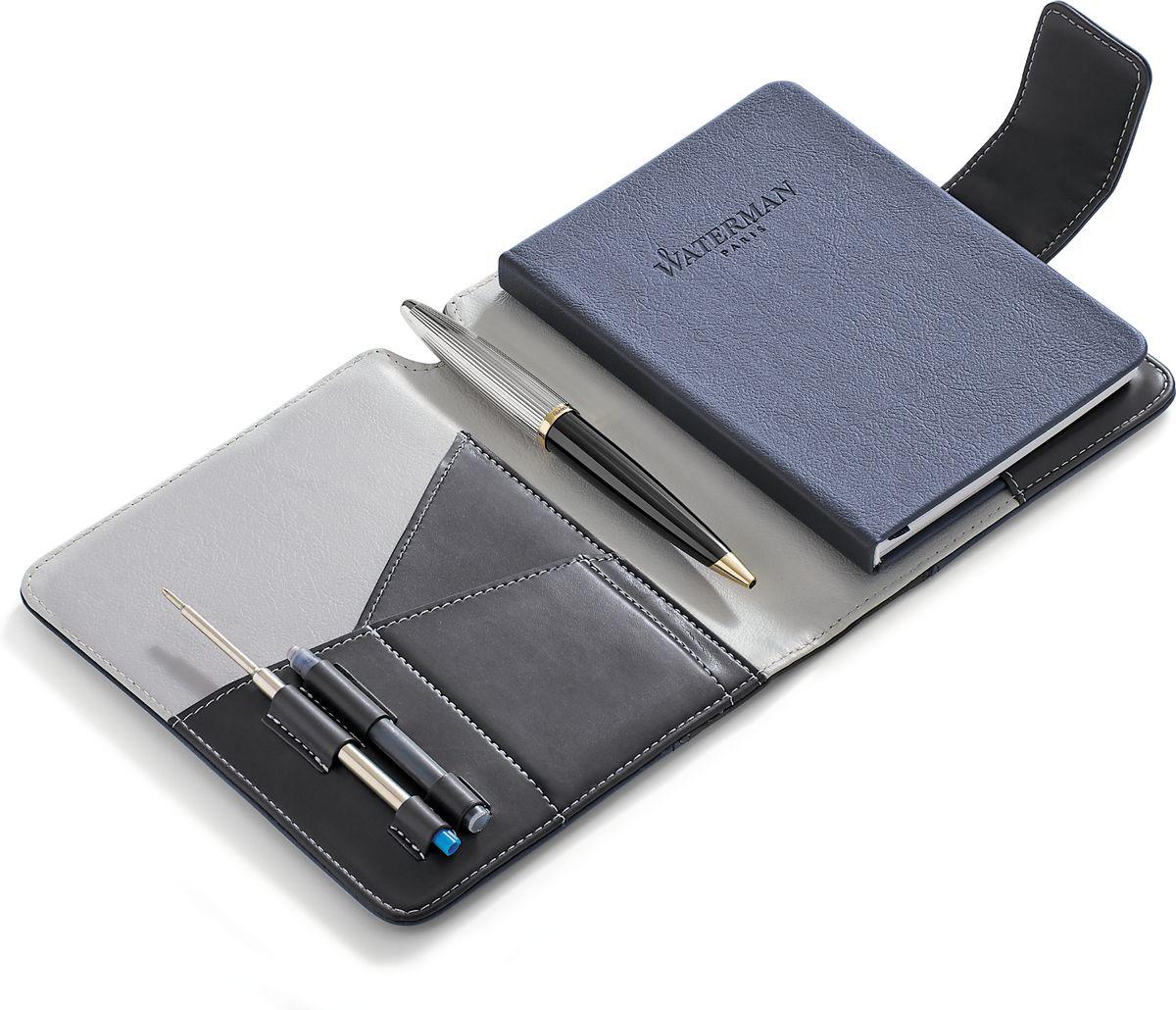 Waterman Шариковая ручка Carene Deluxe Black GT с блокнотомWAT-1978717Шариковая ручка с блокнотом Waterman Carene Deluxe Black GT - это высококачественный канцелярский набор, который будет незаменимым аксессуаром для любого делового человека, а также станет превосходным подарком. В набор входит шариковая ручка, блокнот, стержень и резервуар с чернилами. Блокнот для путешественника с тканевой закладкой-полоской и магнитной застежкой имеет обложку из экокожи,не разлинован, внутренний блок представлен 40 белыми листами. Шариковая ручка Carene Deluxe Black GT имеет лакированный черный корпус, посеребренные и позолоченные детали. Цвет чернил - синий.