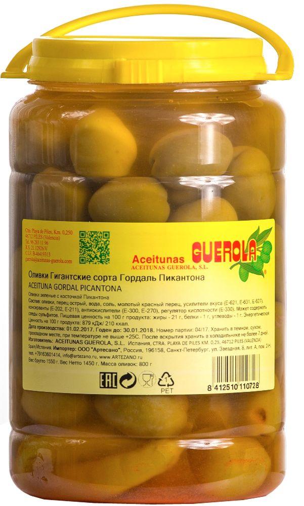 Guerola оливки зеленые Годаль Пикантона калибр 80/90 с косточкой, 800 г8412510110728Оливки зеленые Годаль (или королевские оливки) калибром 80/90 с косточкой с острым перцем чили и красным молотом перцем от испанской семейной компании GUEROLA, которая была основана еще в конце 19 века в Валенсии Рафаэлем Гуэрола и до сих пор ее возглавляют члены семьи. Предприятие выпускает оливки различных видов по традиционных испанским рецептам, консервированные перцы, каперсы и ассорти из этих продуктов. Эти оливки самые большие из существующих на испанском рынке (размером с небольшую сливу). Сорт Гордаль произрастает только в Испании и Греции, но испанские ценятся значительно выше за его тонкую текстуру, гармоничный вкус и косточку маленького размера. В процессе приготовления добавляется немного перца, что придает оливкам пряные ноты. Прекрасно сочетается с плотной едой и хорошим темным вином. Прекрасны как самостоятельное блюдо, так и компонент для салатов, пиццы, бутербродов, канапэ, а также в качестве украшения закусок и соусов