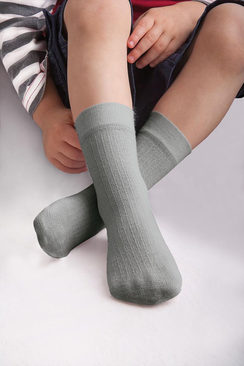 Носки для девочки Knittex, цвет: светло-серый. Dolly. Размер 15/17DollyНоски Knittexсо изготовлены из вискозы, полиамида и эластана, которые обеспечивают отличную посадку. Модель оснащена эластичной резинкой, которая плотно облегает ножку ребенка, не сдавливая ее, обеспечивает удобство.