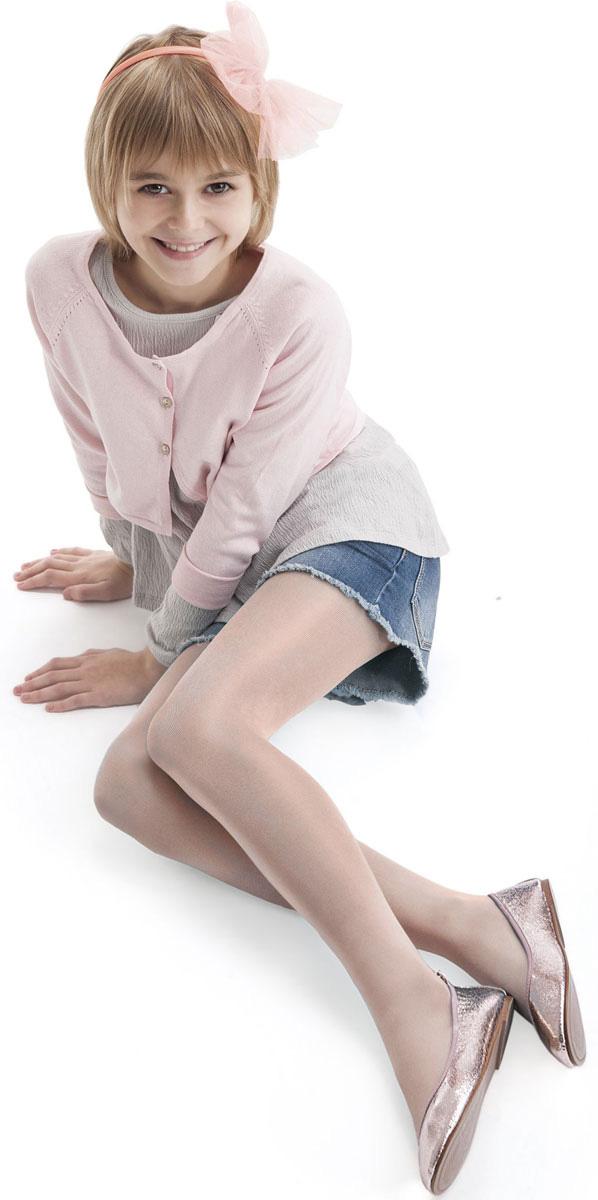 Колготки для девочки Knittex, цвет: светло-розовый. DIVERSE JUNIOR. Размер 152/158DIVERSE JUNIORОднотонные колготки Knittexсо изготовлены из полиамида и эластана, которые обладают свойством эластичности. Модель имеет широкую эластичную резинку на поясе. Колготки равномерно облегают ножки, не сдавливая и не стесняя движения ребенка.
