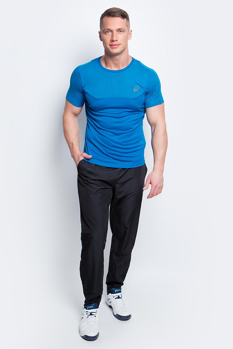 Брюки спортивные мужские Asics Woven Pant, цвет: черный. 134101-0904. Размер S (46/48)134101-0904Спортивные мужские брюки Asics Woven Pant выполнены из плотного полиэстера. Модель имеет широкую резинку на поясе, объем талии регулируется при помощи шнурка-кулиски. Брюки дополнены двумя открытыми втачными карманами спереди. Снизу брючин расположены застежки-молнии. Модель украшена светоотражающими полосками.