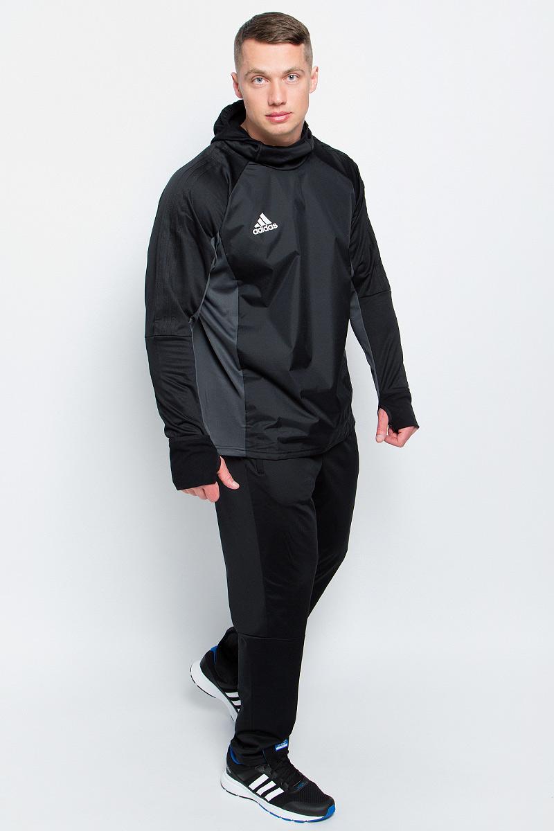 Толстовка для футбола мужская adidas Tiro17 Warm Top, цвет: черный, серый. AY2867. Размер L (52/54)AY2867Мужская футбольная толстовка Adidas Tiro17 Warm Top изготовлена специально для тренировок в прохладную погоду. Модель сохраняет максимум тепла благодаря ткани с технологией climawarm и удлиненным манжетам с прорезями для больших пальцев. Приталенный крой и облегающий капюшон с эластичной окантовкой для дополнительной защиты от холода.