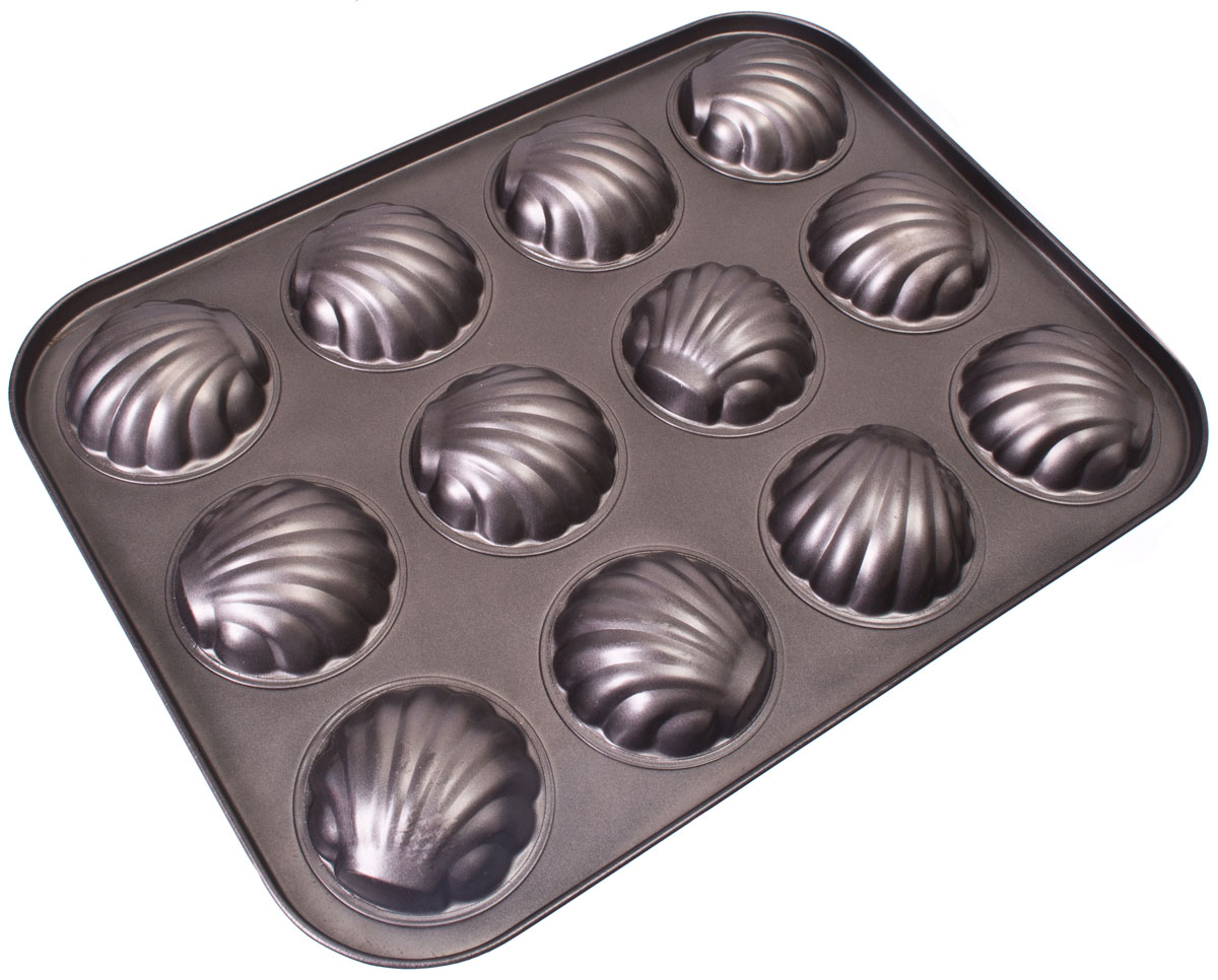 Форма для выпечки Vetta Печенье. Ракушка, 12 ячеек, 35 x 26,5 см846212Форма для выпечки Vetta изготовлена из стали с антипригарным покрытием. Такая форма найдет свое применение для выпечки большинства кулинарных шедевров. Форма равномерно и быстро прогревается, выпечка пропекается равномерно. Благодаря антипригарному покрытию, готовый продукт легко вынимается, а чистка формы не составит большого труда.Какое бы блюдо вы не приготовили, результат будет превосходным!