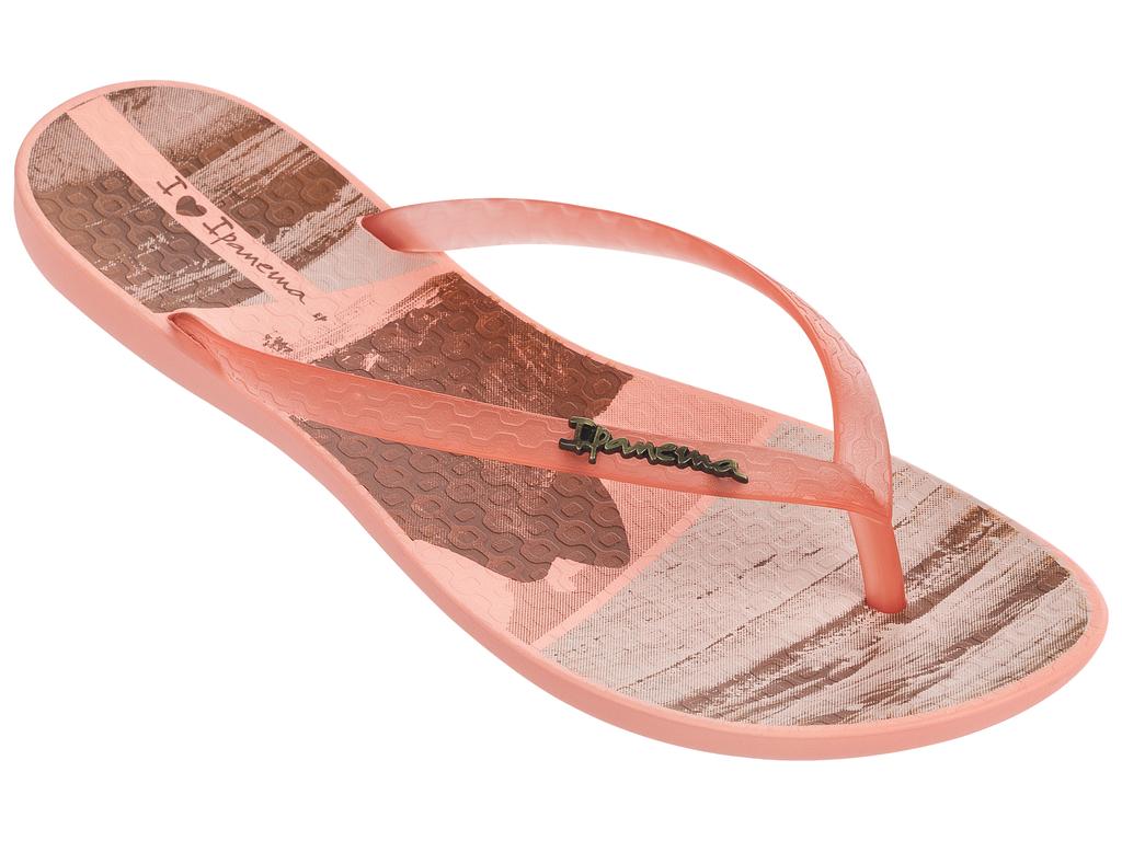 Сланцы женские Ipanema Wave Tropical Fem, цвет: оранжевый. 82119. Размер 35/36 (35)82119-22309Стильные и очень легкие сланцы от Ipanema - придутся вам по душе. Верх модели выполнен из поливинилхлорида. Ремешки с перемычкой гарантируют надежную фиксацию изделия на ноге.Стелька украшена названием бренда и стильным рисунком. Рифление на верхней поверхности подошвы предотвращает выскальзывание ноги. Рельефное основание подошвы обеспечивает уверенное сцепление с любой поверхностью. Удобные сланцы прекрасно подойдут для похода в бассейн или на пляж.