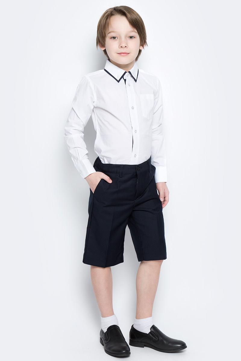 Шорты для мальчика PlayToday, цвет: темно-синий. 461006. Размер 98461006Стильные шорты в классическом стиле для мальчика. Модель прямого кроя со стрелками застегивается на молнию и пуговицу. Изделие дополнено тремя функциональными карманами: двумя втачными спереди и одним прорезным сзади. Имеются шлевки для ремня.