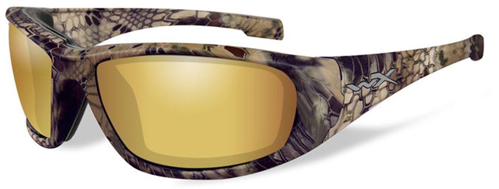 Очки солнцезащитные WileyX Boss Polarized, для охоты, рыбалки и активного отдыха, цвет: Gold Mirror, Amber (Kryptek Highlander)CCBOS12Поляризованные зеркальные янтарно-золотистые линзы очков WileyX Boss Polarized обеспечивают превосходную видимость, как при ярком, так и в слабом освещении, и они идеально подходят для активного отдыха, особенно для рыбалки. Линзы Wiley X, изготовленные из безосколочного поликарбоната с устойчивостью к царапинам, обеспечивают 100% УФ-защиту.Поляризационный фильтр 8ТМ - запатентованная WileyX технология поляризации линз обеспечивает 100% поляризацию и 100% защиту от ультрафиолетовых лучей для непревзойденной четкости и контрастности изображения.Защита от ударов на высокой скорости - оправа и линзы должны выдерживать удар тяжелого снаряда весом 500 г, падающего с высоты 127 см.Прочное покрытие - устойчивое к царапинам покрытие защищает линзы от механических повреждений и продлевает срок их службы.Антибликовое покрытие - антибликовое покрытие устраняет нежелательные отражения с поверхностей линз. Водоотталкивающее покрытие - водоотталкивающее покрытие обеспечивает скатывание воды с поверхности линз. Используется только на поляризационных линзах.