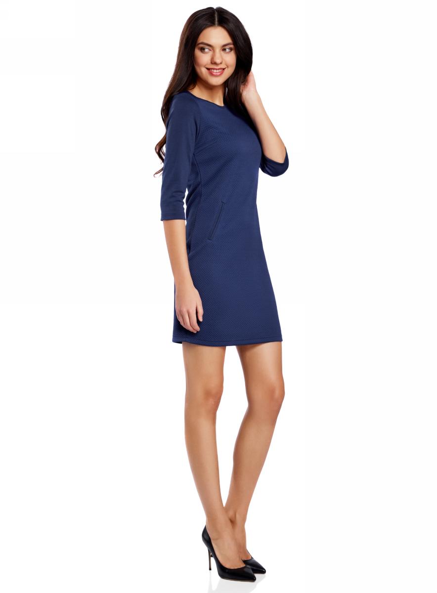 Платье oodji Collection, цвет: синий. 24001100-2/42408/7500N. Размер S (44)24001100-2/42408/7500NПлатье от oodji облегающего силуэта выполнено из высококачественного трикотажа. Модель с рукавами 3/4 дополнена карманами.