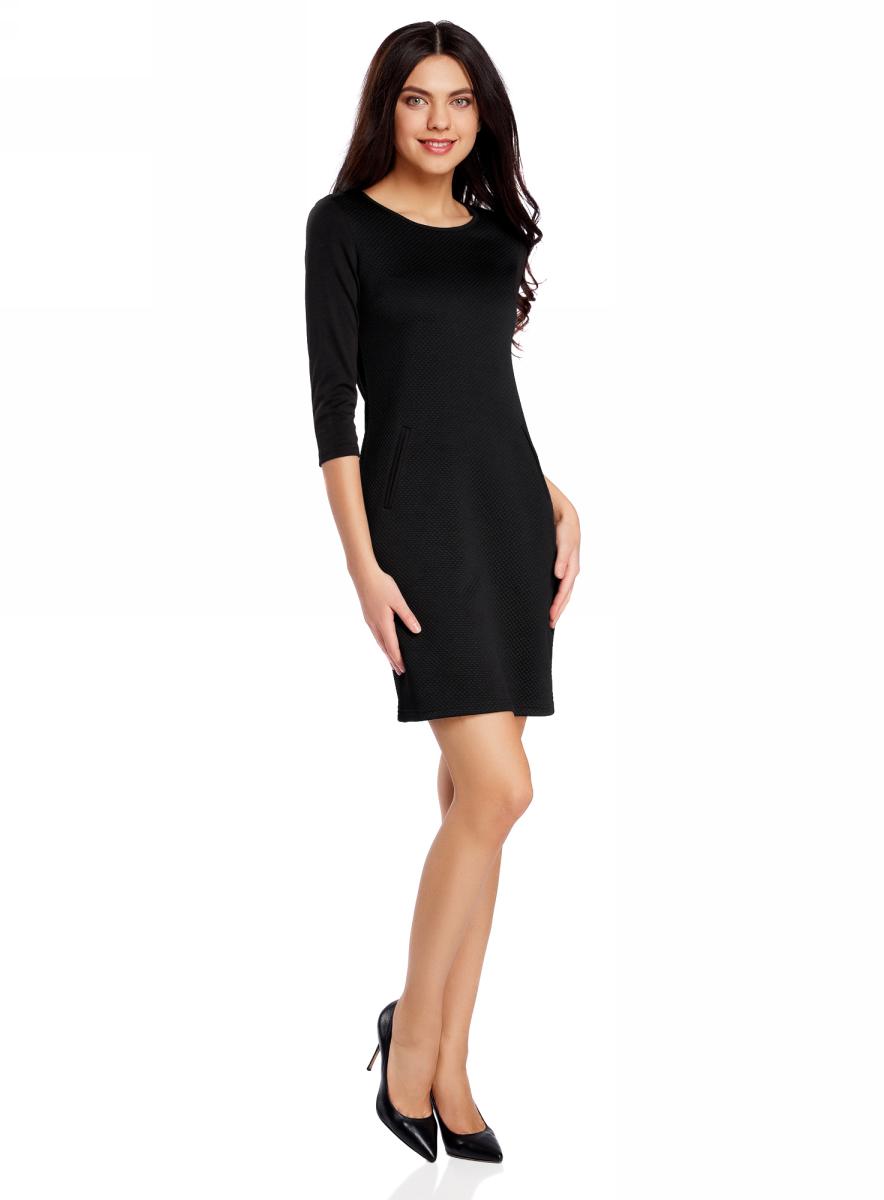Платье oodji Collection, цвет: черный. 24001100-2/42408/2900N. Размер XXL (52)24001100-2/42408/2900NПлатье от oodji облегающего силуэта выполнено из высококачественного трикотажа. Модель с рукавами 3/4 дополнена карманами.
