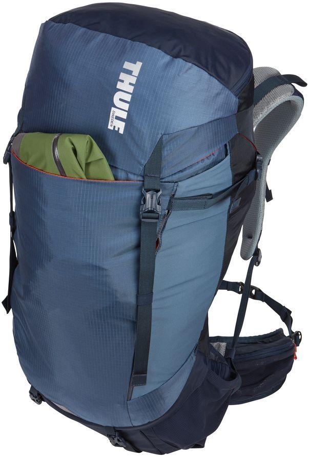 Рюкзак туристический женский Thule Capstone, цвет: синий, 50 л223103Туристический женский рюкзак Thule Capstone идеален для однодневного пешего похода или непродолжительного похода легкого уровня. Имеет полностью регулируемую подвеску, воздухопроницаемую заднюю панель и вшитый дождевой чехол.Особенности:- Система крепления MicroAdjust позволяет отрегулировать ремень для торса на 10 см при надетом рюкзаке, чтобы добиться идеальной посадки.- Сеточная задняя панель натягивается, обеспечивая превосходную воздухопроницаемость и позволяя вам не потеть и оставаться сухим в пути.- Яркая съемная накидка от дождя обеспечивает сухость ваших принадлежностей во время ливней.- Регулируемый поясной ремень совместим со взаимозаменяемыми аксессуарами VersaClick (приобретаются отдельно).- С помощью держателя палок VersaClick, входящего в комплект поставки, можно удобно закрепить трекинговые палки на поясном ремне, не снимая рюкзак.- Небольшие принадлежности можно хранить в карманах на молнии в верхнем клапане и в поясном ремне.- Доступ к содержимому сверху, снизу и сбоку упрощает загрузку и разгрузку рюкзака и позволяет легко найти нужную вещь во время пути.- Эластичный карман Shove-it Pocket обеспечивает быстрый доступ к часто используемым предметам.- Можно легко переместить снаряжение в переднюю часть рюкзака с помощью ремешка, продетого сквозь прочную петлю.- Задние крепления для трекинговых палок и ледоруба можно убрать, если они не используются.