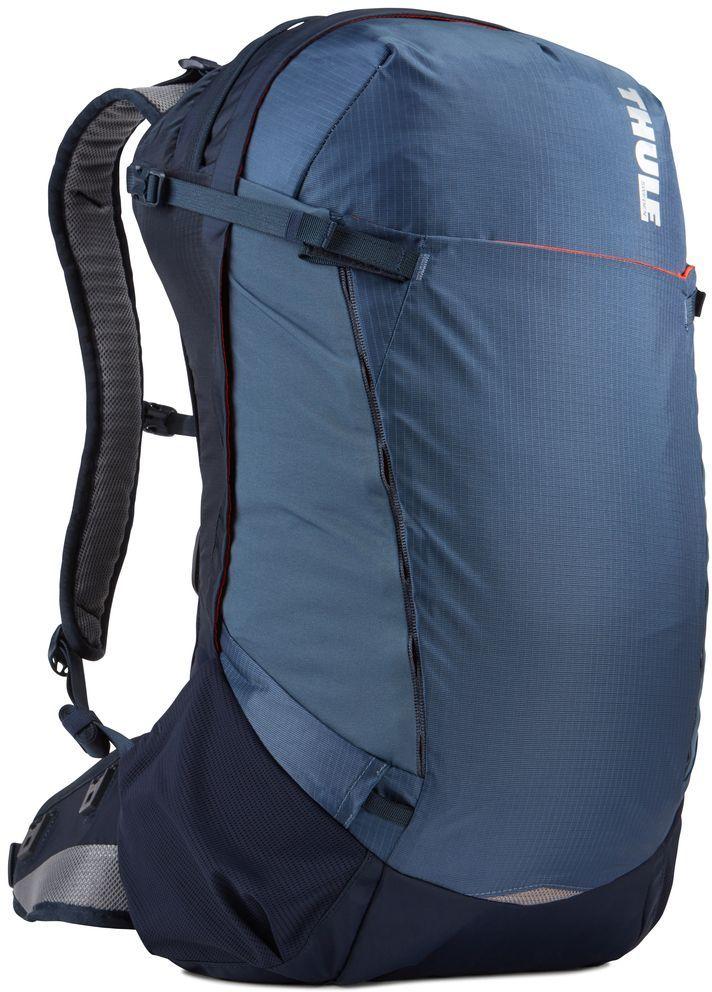 Рюкзак туристический мужской Thule Capstone, цвет: синий, 32 л224101Туристический мужской рюкзак Thule Capstone подходит для путешествий на целый день, имеет регулируемую подвеску, воздухопроницаемую заднюю панель и вшитый дождевой чехол.Особенности: - Система крепления MicroAdjust позволяет отрегулировать ремень для торса на 10 см при надетом рюкзаке, чтобы добиться идеальной посадки.- Сеточная задняя панель натягивается, обеспечивая превосходную воздухопроницаемость и позволяя вам не потеть и оставаться сухим в пути.- Яркая съемная накидка от дождя обеспечивает сухость ваших принадлежностей во время ливней.- Регулируемый поясной ремень совместим со взаимозаменяемыми аксессуарами VersaClick (приобретаются отдельно).- С помощью держателя палок VersaClick, входящего в комплект поставки, можно удобно закрепить трекинговые палки на поясном ремне, не снимая рюкзак.- Карман на молнии в верхней части рюкзака предназначен для хранения небольших предметов.- В карман на поясном ремне можно положить еду, телефон или небольшие предметы.- Эластичный карман Shove-it Pocket обеспечивает быстрый доступ к часто используемым предметам.- Можно легко переместить снаряжение в переднюю часть рюкзака с помощью ремешка, продетого сквозь прочную петлю.- Задние крепления для трекинговых палок и ледоруба можно убрать, если они не используются.
