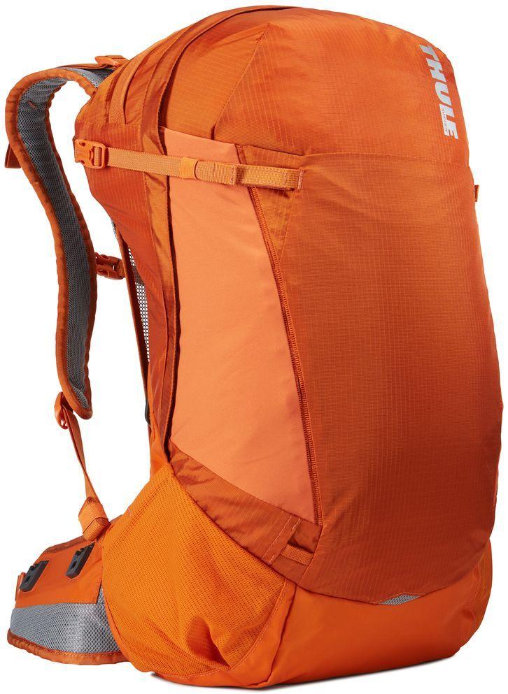 Рюкзак туристический мужской Thule Capstone, цвет: коричневый, 32 л224102Туристический мужской рюкзак Thule Capstone подходит для путешествий на целый день, имеет регулируемую подвеску, воздухопроницаемую заднюю панель и вшитый дождевой чехол.Особенности: - Система крепления MicroAdjust позволяет отрегулировать ремень для торса на 10 см при надетом рюкзаке, чтобы добиться идеальной посадки.- Сеточная задняя панель натягивается, обеспечивая превосходную воздухопроницаемость и позволяя вам не потеть и оставаться сухим в пути.- Яркая съемная накидка от дождя обеспечивает сухость ваших принадлежностей во время ливней.- Регулируемый поясной ремень совместим со взаимозаменяемыми аксессуарами VersaClick (приобретаются отдельно).- С помощью держателя палок VersaClick, входящего в комплект поставки, можно удобно закрепить трекинговые палки на поясном ремне, не снимая рюкзак.- Карман на молнии в верхней части рюкзака предназначен для хранения небольших предметов.- В карман на поясном ремне можно положить еду, телефон или небольшие предметы.- Эластичный карман Shove-it Pocket обеспечивает быстрый доступ к часто используемым предметам.- Можно легко переместить снаряжение в переднюю часть рюкзака с помощью ремешка, продетого сквозь прочную петлю.- Задние крепления для трекинговых палок и ледоруба можно убрать, если они не используются.