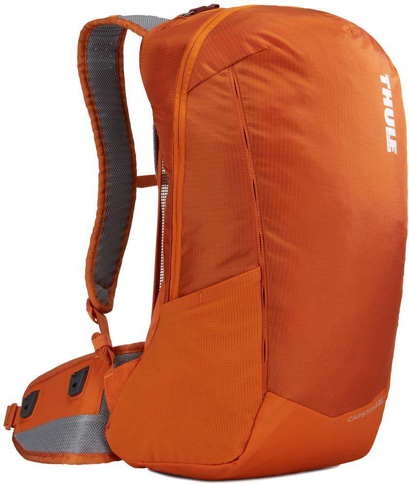 Рюкзак туристический мужской Thule Capstone, цвет: оранжевый, 22 л. Размер M/L225102Мужской рюкзак Thule Capstone идеально подходит для однодневных путешествий или коротких походов. Рюкзак снабжен яркой накидкой от дождя и системой крепления MicroAdjust, которая обеспечивает максимальную регулировку для идеальной посадки. Сзади расположена натягиваемая сеточная панель для максимальной воздухопроницаемости. Рюкзак оснащен 1 вместительным отделением на застежке-молнии. Спереди имеется 2 кармана, один из которых на застежке-молнии. По бокам расположено 2 эластичных кармана. На набедренном ремне имеется 2 небольших кармана.Что взять с собой в поход?. Статья OZON Гид