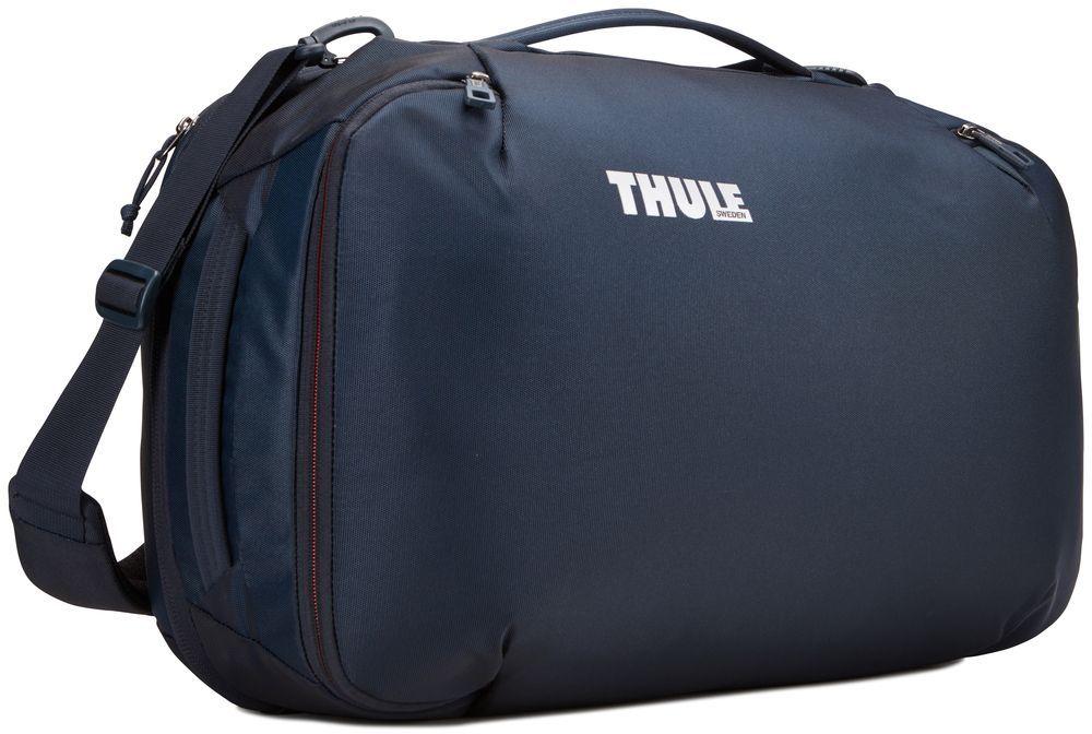 Сумка дорожная Thule Subterra Carry-On, цвет: темно-синий, 40 л3203444Универсальная мягкая сумка отличается исключительной вместимостью. Имеет встроенный чехол для ноутбука, который очень пригодится в поездке. Также здесь присутствует отделение PowerPocket, в котором может располагаться внешний аккумулятор для подзарядки гаджетов. Имеет три варианта переноски: через плечо, за ручку и как рюкзак. Подходит под требования многих авиакомпаний, предъявляемых к ручной клади. Размер сумки: 21 x 35 x 55 см.
