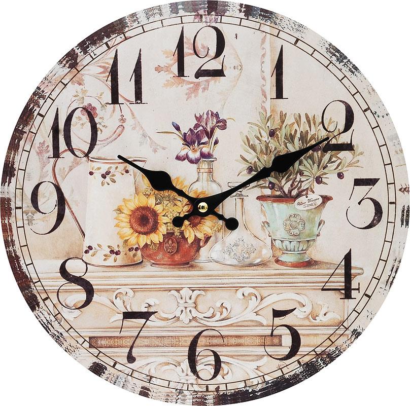 Часы настенные Белоснежка Цветы и олива, диаметр 34 см120-CLЧасы настенные Белоснежка станут изюминкой в дизайне интерьера вашего дома. Открытый циферблат выполнен из листа оргалита с декоративным покрытием. Часы имеют две стрелки – часовую и минутную. Часовой механизм сзади закрыт пластиковым корпусом. Предусмотрено отверстие для крепления на стену. Питание от одной батарейки стандарта АА (в комплект не входит).Диаметр часов: 34 см.