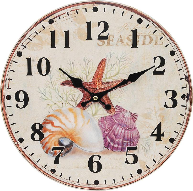Часы настенные Белоснежка Морские сокровища, диаметр 34 см132-CLЧасы настенные Белоснежка станут изюминкой в дизайне интерьера вашего дома. Открытый циферблат выполнен из листа оргалита с декоративным покрытием. Часы имеют две стрелки – часовую и минутную. Часовой механизм сзади закрыт пластиковым корпусом. Предусмотрено отверстие для крепления на стену.Питание от одной батарейки стандарта АА (в комплект не входит). Диаметр часов: 34 см.