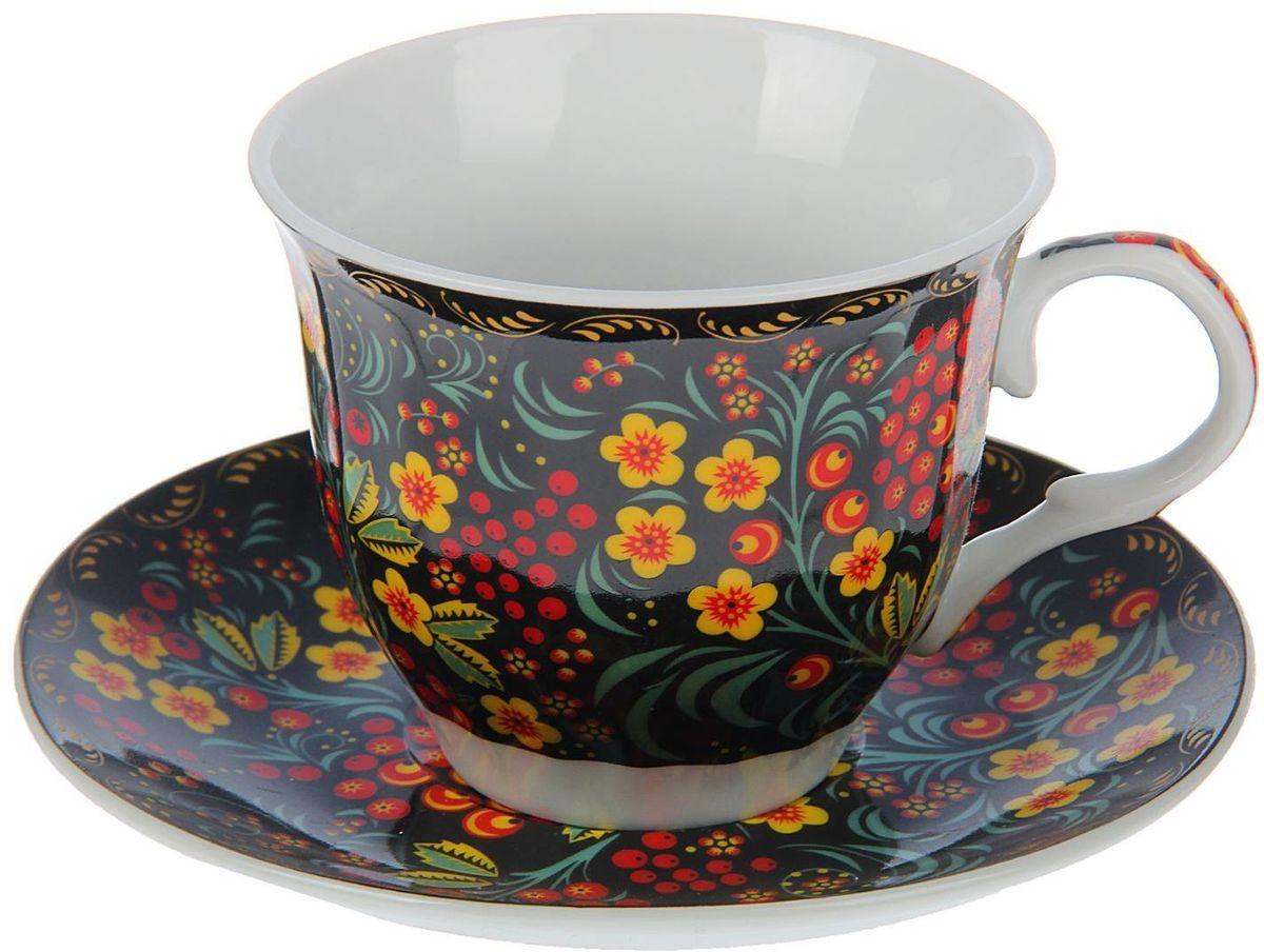 Набор чайный Доляна Хохлома, 2 предмета1405164Какую посуду выбрать для чаепития? Конечно, традиционный напиток по необходимости можно пить и из помятой алюминиевой кружки. Но все-таки большинство хозяек стараются приобрести изящные и оригинальные модели для эстетического наслаждения неповторимым вкусом и тонким ароматом хорошего чая.Кухонная керамика сочетает в себе бытовую практичность и декоративную утонченность. Нарядный комплект обязательных для чаепития атрибутов изготовлен на родине древнего напитка и привнесет в каждую трапезу особую энергетику.