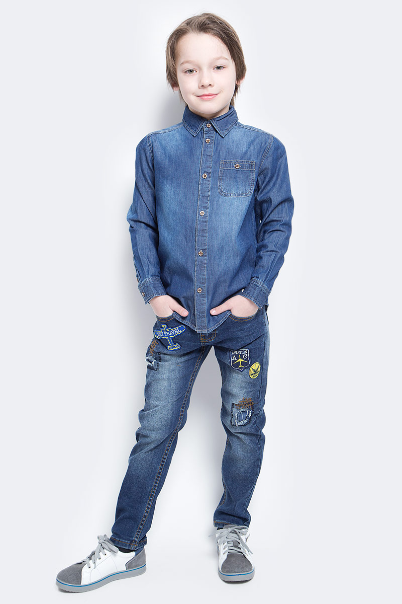 Рубашка для мальчика Sela, цвет: синий джинс. Hj-832/005-7112. Размер 152, 12 летHj-832/005-7112Джинсовая рубашка для мальчика Sela выполнена из натурального хлопка с эффектом потертостей. Модель прямого кроя с длинными рукавами и отложным воротничком застегивается на пуговицы и дополнена накладным карманом на пуговице на груди. Манжеты рукавов также застегиваются на пуговицы.