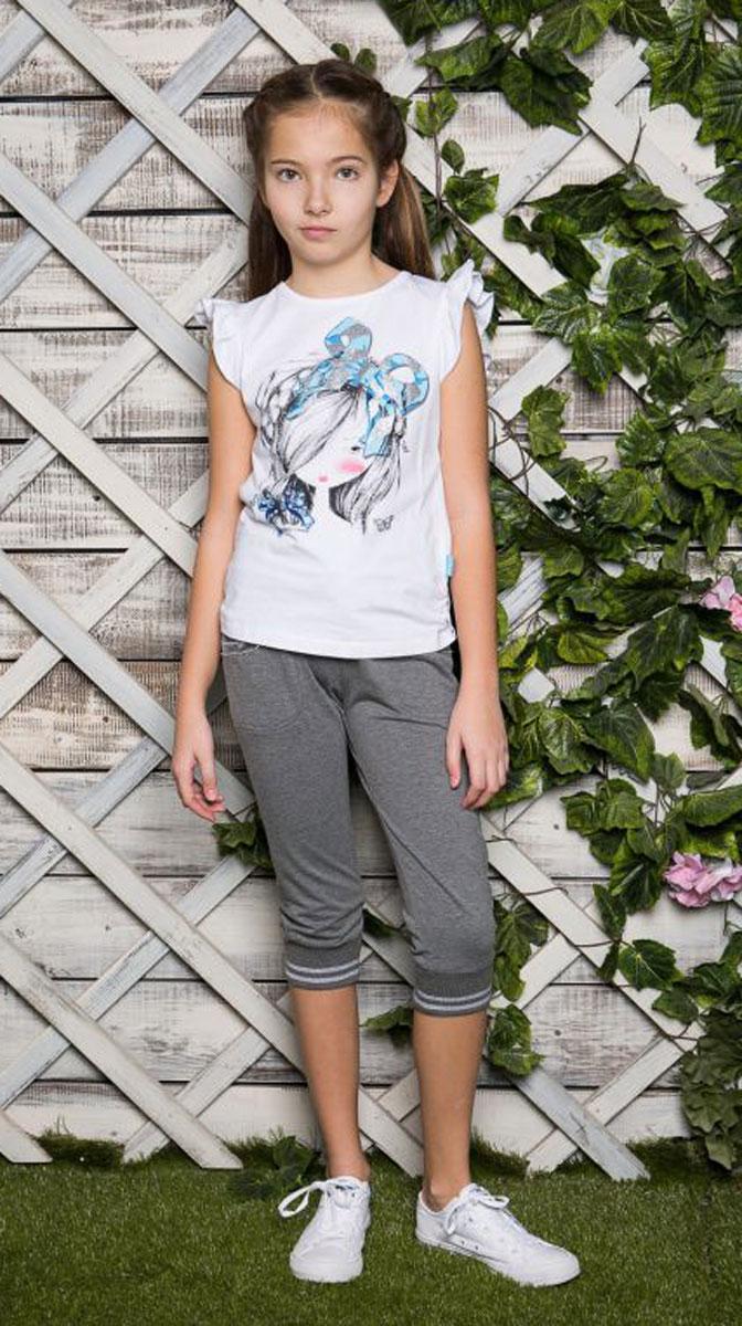 Футболка для девочки Luminoso, цвет: белый. 718046. Размер 158718046Футболка из трикотажной ткани с рукавами-крылышками. Декорирована яркой аппликацией и стразами. По бокам изделие собрано на мягкую резинку.