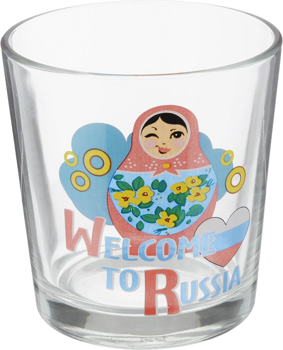 """Стакан OSZ """"Ода. Вэлкам ту раша. Матрешка"""" изготовлен из стекла и декорирован принтом. Диаметр (по верхнему краю): 8 см. Высота: 8,5 см. Объем: 250 мл."""
