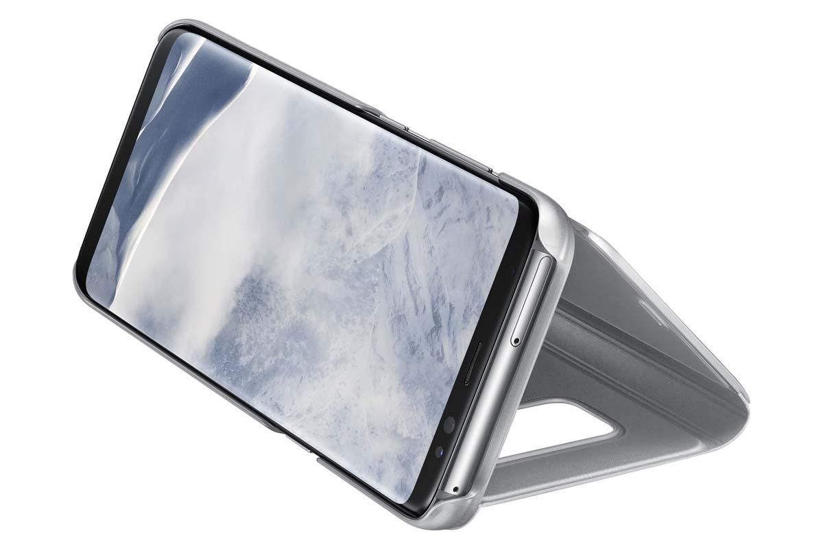 Samsung EF-ZG950C Clear View Standing чехол для Galaxy S8, SilverEF-ZG950CSEGRUТонкий полупрозрачный чехол Samsung Clear View Standing подчеркивает стиль и изящество смартфона Galaxy S8. Аксессуар обеспечивает быстрый доступ к функциям – следите за информацией на экране, не открывая чехла. Сквозь прозрачную верхнюю крышку видны время, пропущенные вызовы, индикатор заряда. Флип-кейс отзывчиво реагирует на прикосновения – отвечайте на звонки одним легким движением. Чехол устойчив к появлению отпечатков пальцев – ваш смартфон всегда в аккуратном состоянии. Особое покрытие чехла защищает смартфон от повреждений, продлевая срок его службы.