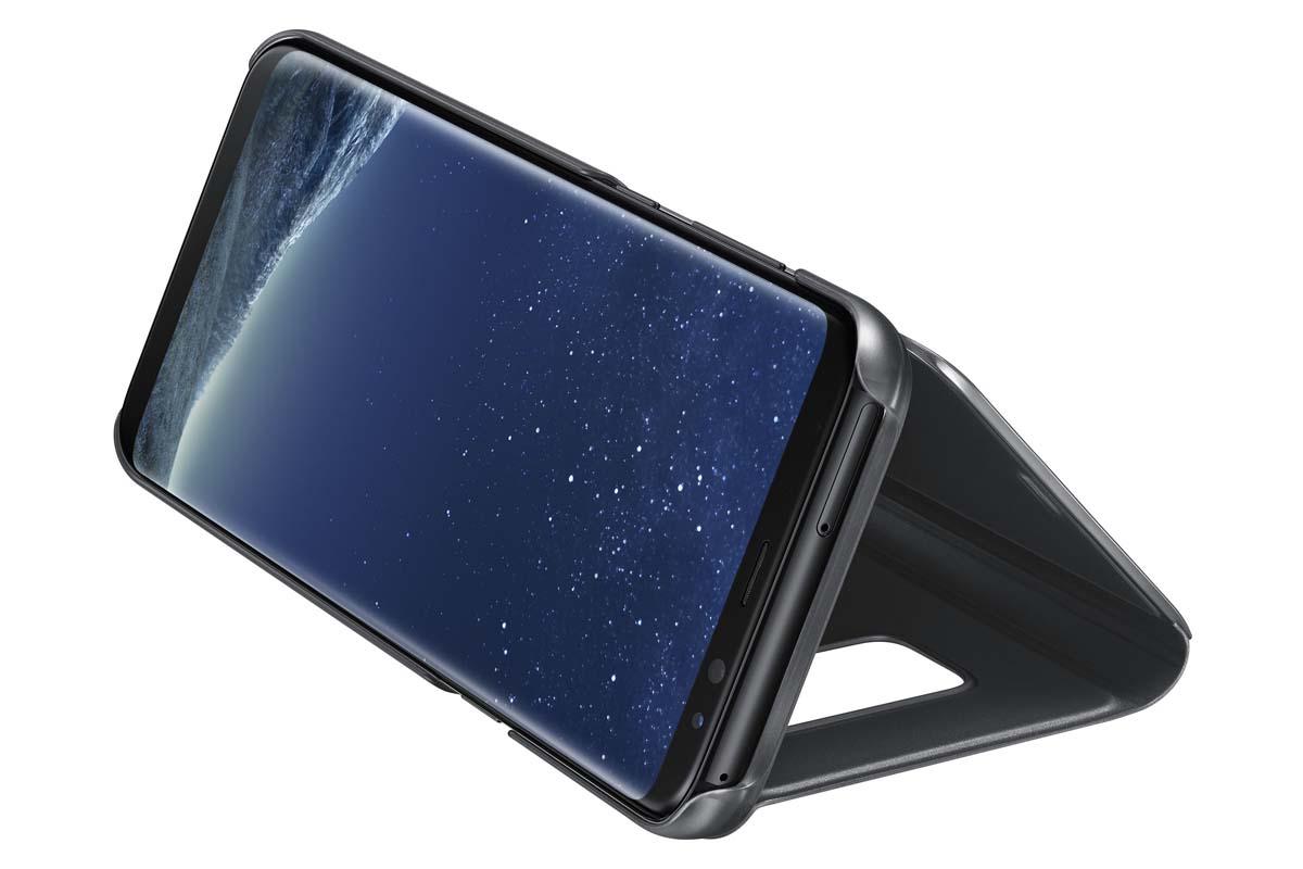 Samsung EF-ZG955C Clear View Standing чехол для Galaxy S8+, BlackEF-ZG955CBEGRUТонкий полупрозрачный чехол Samsung Clear View Standing подчеркивает стиль и изящество смартфона Galaxy S8+. Аксессуар обеспечивает быстрый доступ к функциям – следите за информацией на экране, не открывая чехла. Сквозь прозрачную верхнюю крышку видны время, пропущенные вызовы, индикатор заряда. Флип-кейс отзывчиво реагирует на прикосновения – отвечайте на звонки одним легким движением. Чехол устойчив к появлению отпечатков пальцев – ваш смартфон всегда в аккуратном состоянии. Особое покрытие чехла защищает смартфон от повреждений, продлевая срок его службы.