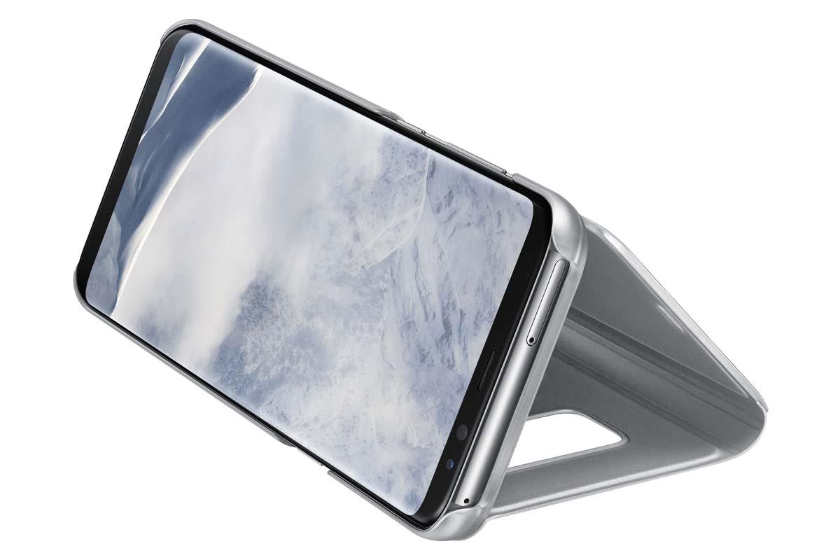Samsung EF-ZG955C Clear View Standing чехол для Galaxy S8+, SilverEF-ZG955CSEGRUТонкий полупрозрачный чехол Samsung Clear View Standing подчеркивает стиль и изящество смартфона Galaxy S8+. Аксессуар обеспечивает быстрый доступ к функциям – следите за информацией на экране, не открывая чехла. Сквозь прозрачную верхнюю крышку видны время, пропущенные вызовы, индикатор заряда. Флип-кейс отзывчиво реагирует на прикосновения – отвечайте на звонки одним легким движением. Чехол устойчив к появлению отпечатков пальцев – ваш смартфон всегда в аккуратном состоянии. Особое покрытие чехла защищает смартфон от повреждений, продлевая срок его службы.