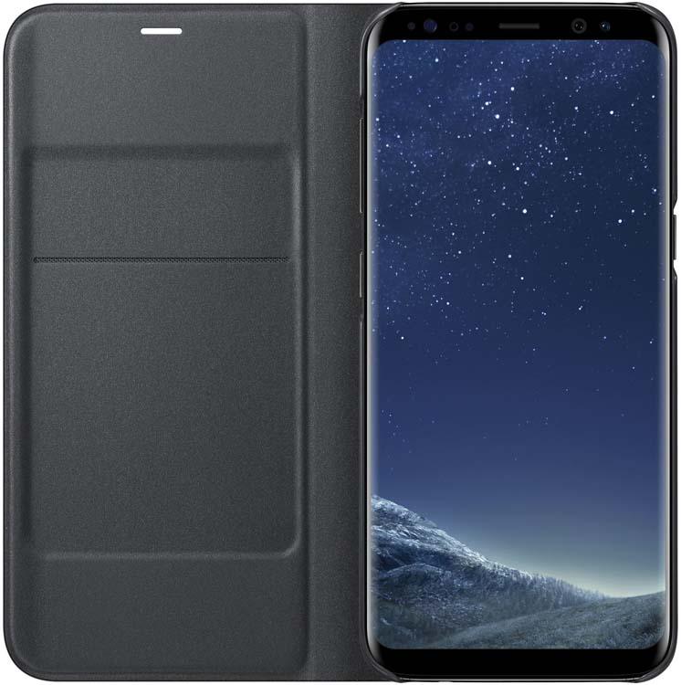 Samsung EF-NG950 LED-View чехол для Galaxy S8, BlackEF-NG950PBEGRUЧехол LED View Cover предназначен для флагмана от Samsung - Galaxy S8. Верхняя крышка флип-кейса оснащена чувствительным сенсором, который реагирует на открытие/закрытие и нажатие кнопки питания. На передней панели чехла отображается текущая информация экрана - время, процент заряда, пропущенные вызовы и смс. Очередная фишка чехла - возможность отвечать на звонки, не открывая его, - просто проведите пальцем по панели, как по экрану. Чехол плотно прилегает к смартфону и предохраняет модель от падений и попадания пыли.