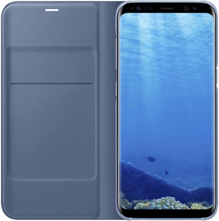 Samsung EF-NG950 LED-View чехол для Galaxy S8, BlueEF-NG950PLEGRUЧехол LED View Cover предназначен для флагмана от Samsung - Galaxy S8. Верхняя крышка флип-кейса оснащена чувствительным сенсором, который реагирует на открытие/закрытие и нажатие кнопки питания. На передней панели чехла отображается текущая информация экрана - время, процент заряда, пропущенные вызовы и смс. Очередная фишка чехла - возможность отвечать на звонки, не открывая его, - просто проведите пальцем по панели, как по экрану. Чехол плотно прилегает к смартфону и предохраняет модель от падений и попадания пыли.
