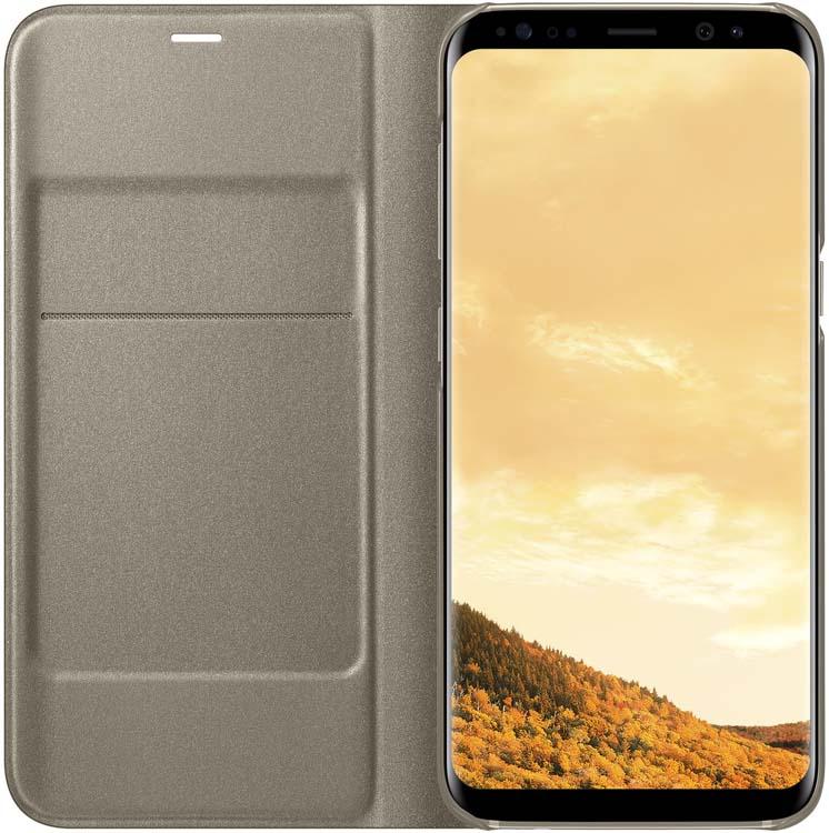 Samsung EF-NG950 LED-View чехол для Galaxy S8, GoldEF-NG950PFEGRUЧехол LED View Cover предназначен для флагмана от Samsung - Galaxy S8. Верхняя крышка флип-кейса оснащена чувствительным сенсором, который реагирует на открытие/закрытие и нажатие кнопки питания. На передней панели чехла отображается текущая информация экрана - время, процент заряда, пропущенные вызовы и смс. Очередная фишка чехла - возможность отвечать на звонки, не открывая его, - просто проведите пальцем по панели, как по экрану. Чехол плотно прилегает к смартфону и предохраняет модель от падений и попадания пыли.