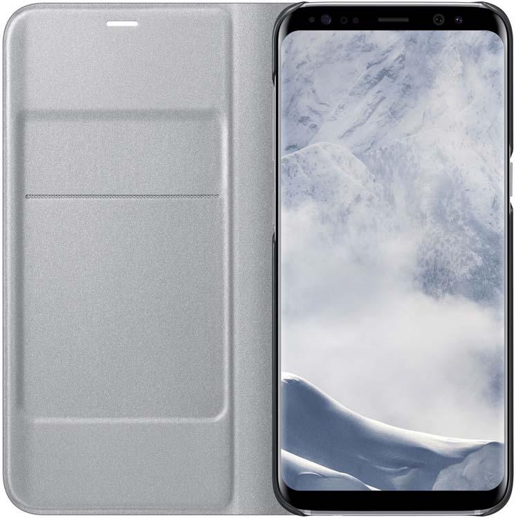 Samsung EF-NG950 LED-View чехол для Galaxy S8, SilverEF-NG950PSEGRUЧехол LED View Cover предназначен для флагмана от Samsung - Galaxy S8. Верхняя крышка флип-кейса оснащена чувствительным сенсором, который реагирует на открытие/закрытие и нажатие кнопки питания. На передней панели чехла отображается текущая информация экрана - время, процент заряда, пропущенные вызовы и смс. Очередная фишка чехла - возможность отвечать на звонки, не открывая его, - просто проведите пальцем по панели, как по экрану. Чехол плотно прилегает к смартфону и предохраняет модель от падений и попадания пыли.