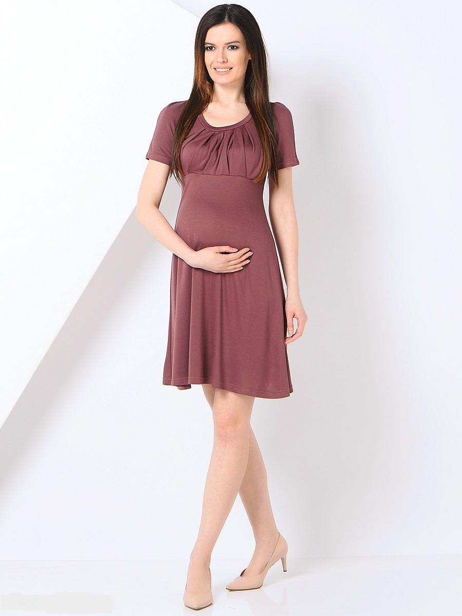 Платье для беременных 40 недель, цвет: светло-коричневый. 301355. Размер 46301355Платье для беременных от бренда 40 недель - прекрасный вариант на каждый день. Изделие выполнено из хлопка с добавлением лайкры. Модель с коротким рукавом-реглан и круглым вырезом горловины. Оригинально задрапированный лиф и трапециевидный покрой создают элегантный образ уверенной в себе женщины. Благодаря уникальному крою это платье вы сможете носить на протяжении всего срока беременности и после него. Такое платье идеальный вариант для различных мероприятий и для работы в офисе.