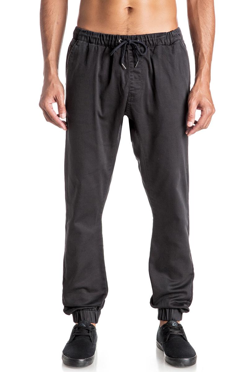 Брюки мужские Quiksilver, цвет: темно-серый. EQYNP03107-KTA0. Размер L (52)EQYNP03107-KTA0Стильные мужские брюки джоггеры Quiksilver со слегка заниженной ластовицей изготовлены из эластичного хлопка. Модель на талии имеет широкую эластичную резинку и дополнена затягивающимся шнурком и имитацией ширинки. Спереди брюки имеют два прорезных кармана и один небольшой накладной карман, сзади два прорезных кармана на застежках-пуговицах. Низ брючин дополнен резинками.
