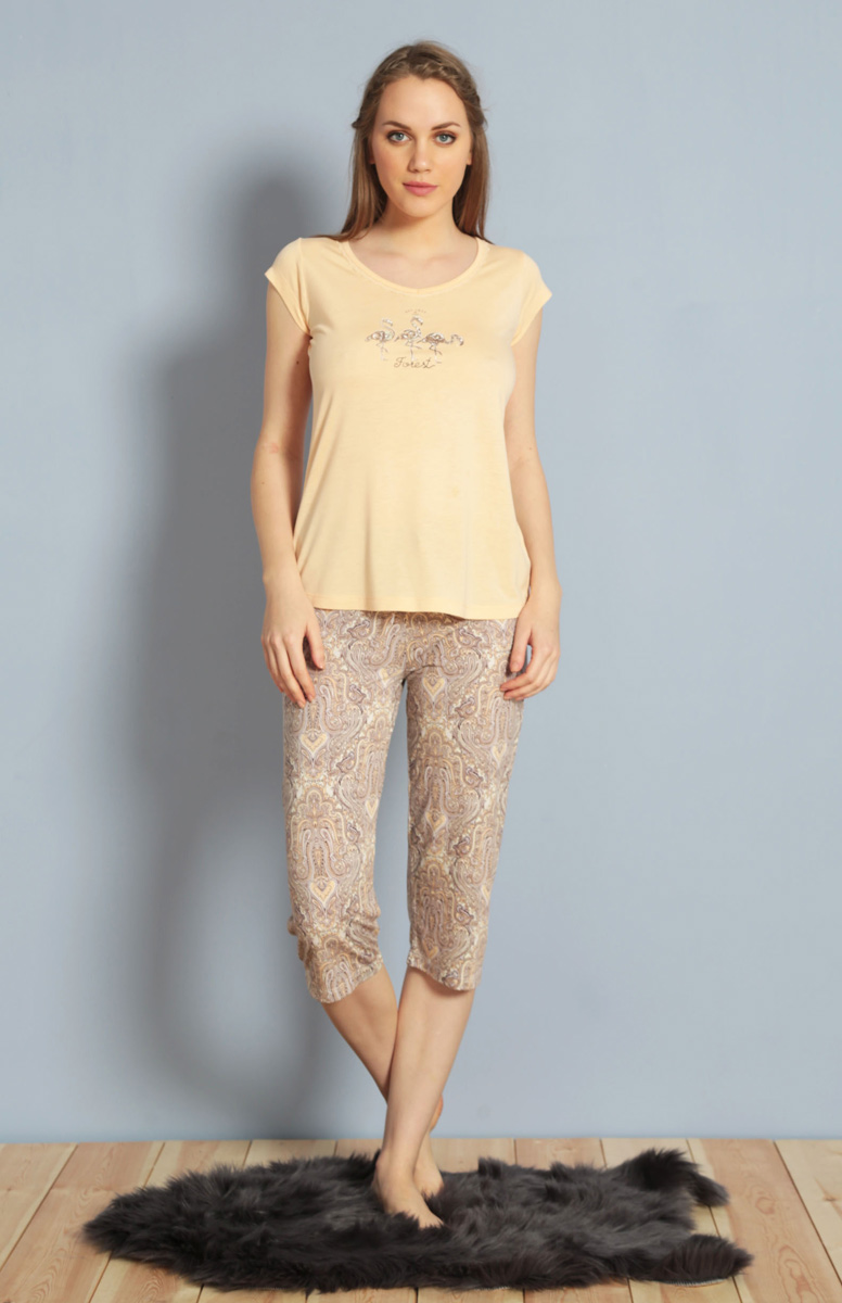 Домашний комплект женский Kezokino, цвет: персиковый. 610159 0619. Размер XL (50)610159 0619Красивый комплект, выполненный из 100% вискозы, состоит из футболки и капри приятной расцветки. Отличный вариант для дома и отдыха на каждый день.