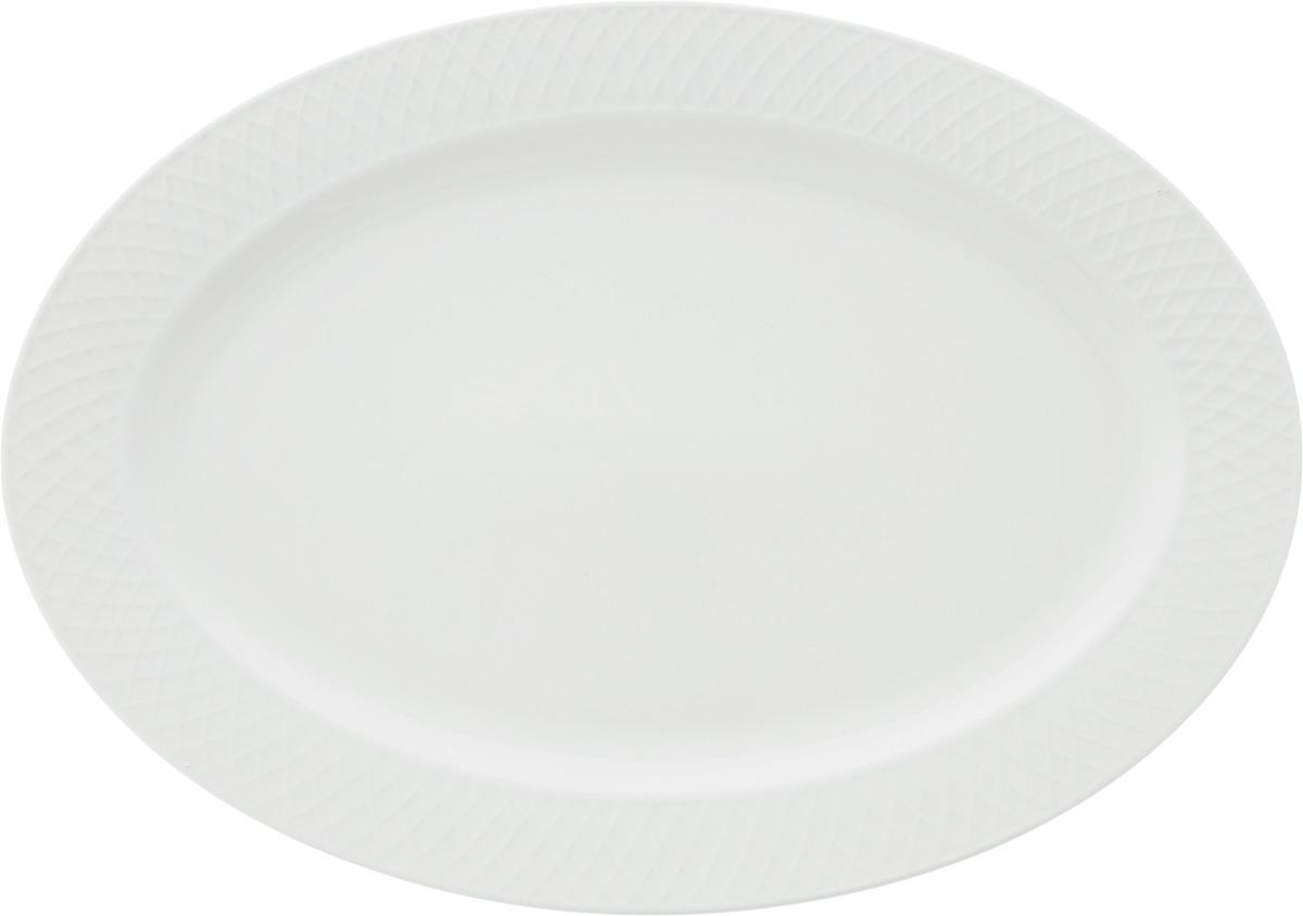 Блюдо Wilmax, овальное, 35 х 25 смWL-880103-JV / 1CБлюдо Wilmax овальной формы изготовлено из высококачественного фарфора с глазурованным покрытием. Материал легкий, тонкий, свет без труда проникает сквозь изделие. Посуда имеет роскошную белизну, гладкость и блеск достигаются за счет особой рецептуры глазури. Изделие обладает низкой водопоглощаемостью, высокой термостойкостью и ударопрочностью, а также экологичностью. Посуда долговечна и рассчитана на постоянное интенсивное использование. Гладкая непористая поверхность исключает проникновение бактерий, изделие не будет впитывать посторонние запахи и сохранит первоначальный цвет. Блюдо прекрасно подойдет для подачи различных закусок, нарезок, сладостей, фруктов. Такое блюдо украсит ваш праздничный или обеденный стол, а оригинальный дизайн придется по вкусу и ценителям классики, и тем, кто предпочитает утонченность и изысканность.Можно мыть в посудомоечной машине и использовать в микроволновой печи.