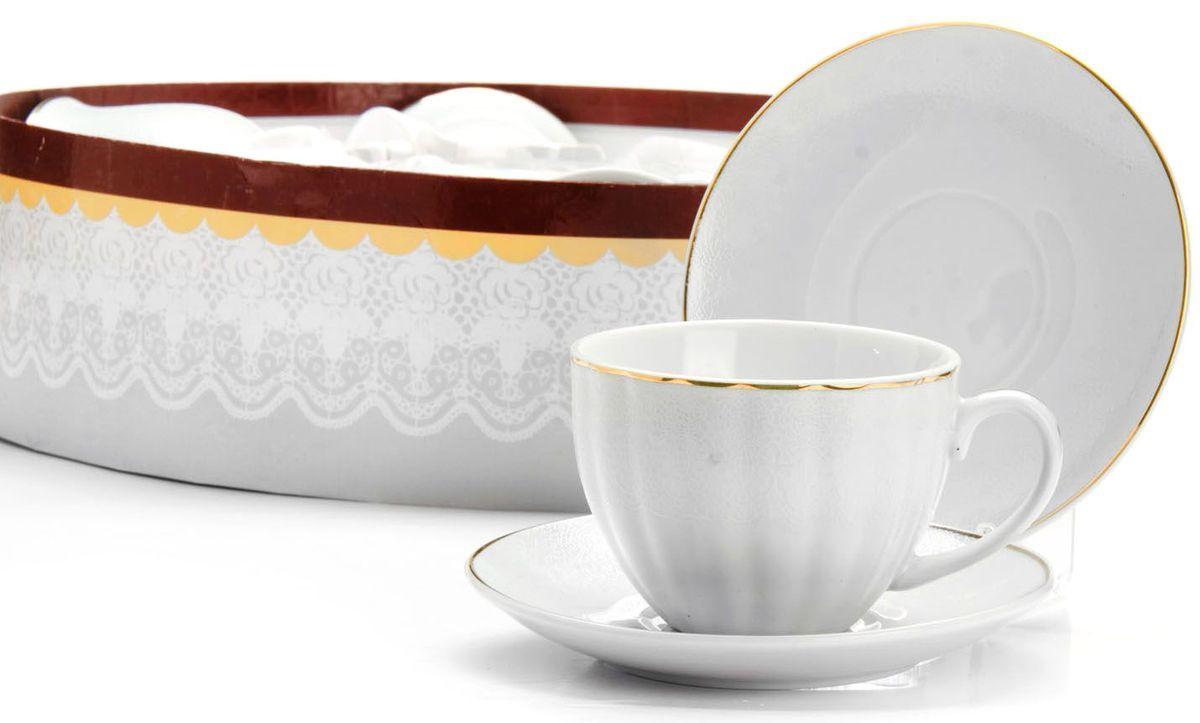 Чайный сервиз Loraine, 12 предметов, 220 мл. 2641726417Чайный набор Loraine на 6 персон, изготовленный из высококачественного костяного фарфора, состоит из 6 чашек и 6 блюдец. Набор придется по вкусу и ценителям классики, и тем, кто предпочитает утонченность и изысканность. Он настроит на позитивный лад и подарит хорошее настроение с самого утра. Набор упакован в подарочную упаковку. Такой чайный набор станет прекрасным украшением стола, а процесс чаепития превратится в одно удовольствие! Это замечательный выбор для подарка родным и друзьям!Объем чашки: 220 мл.