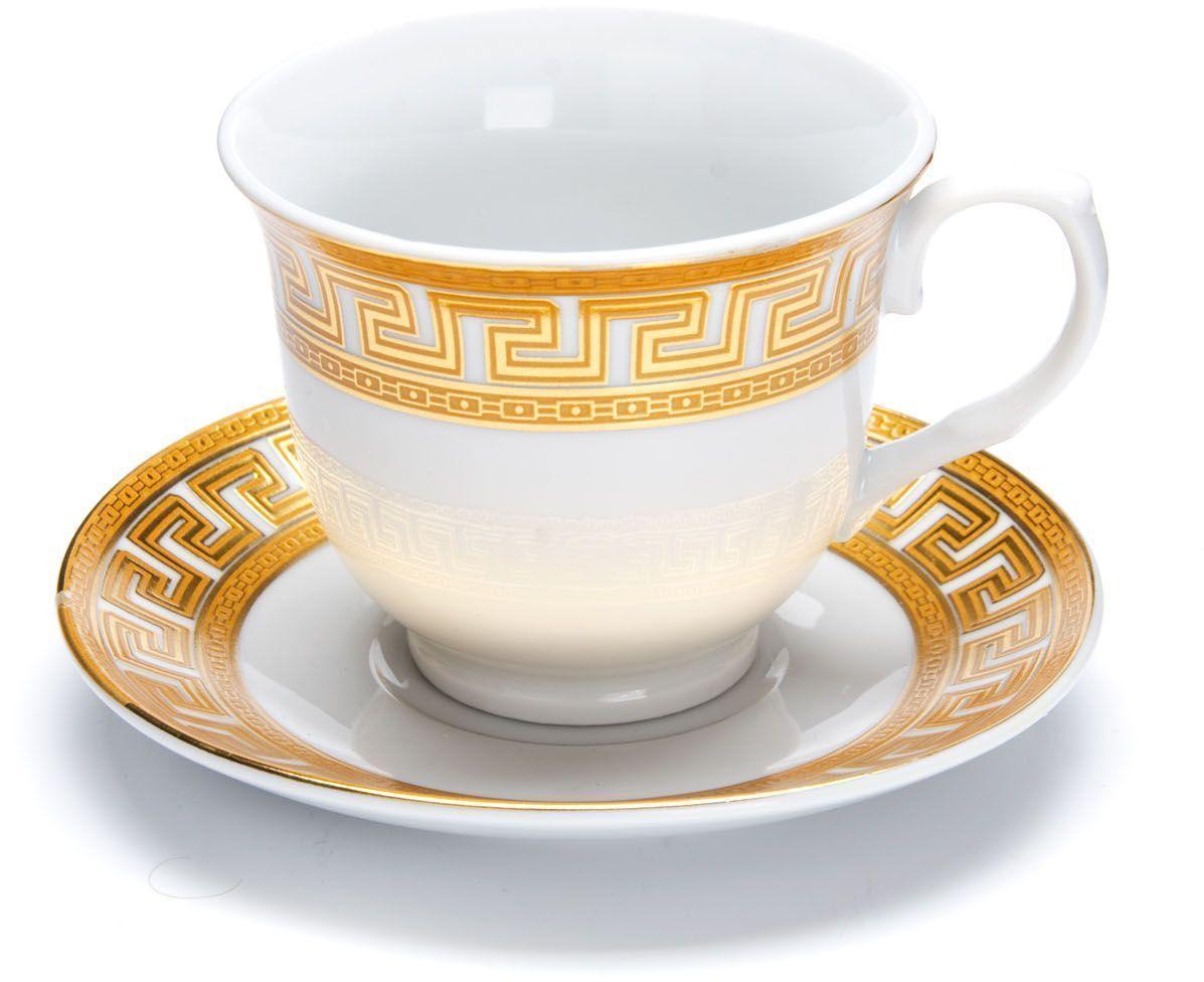 Чайный сервиз Loraine Версаче, 12 предметов, 220 мл. 2642226422Чайный сервиз Loraine на 6 персон выполнен из высококачественной керамики белого цвета и украшен широким золотым орнаментом в греческом стиле. Изящный дизайн придется по вкусу и ценителям классики, и тем, кто предпочитает утонченность и изысканность.Сервиз упакован в круглую подарочную коробку. Каждый предмет надежно зафиксирован внутри коробки благодаря специальным выемкам.Элегантный и стильный чайный сервиз не только украсит сервировку стола, но и поднимет настроение и превратит процесс чаепития в одно удовольствие.Чайный сервиз - идеальный и необходимый подарок для вашего дома и для ваших друзей в праздники, юбилеи и торжества!В наборе 6 чашек и 6 блюдец.Диаметр чашки: 9 см.Высота чашки: 8 см.Объем чашки: 220 мл.Диаметр блюдца: 13,5 см