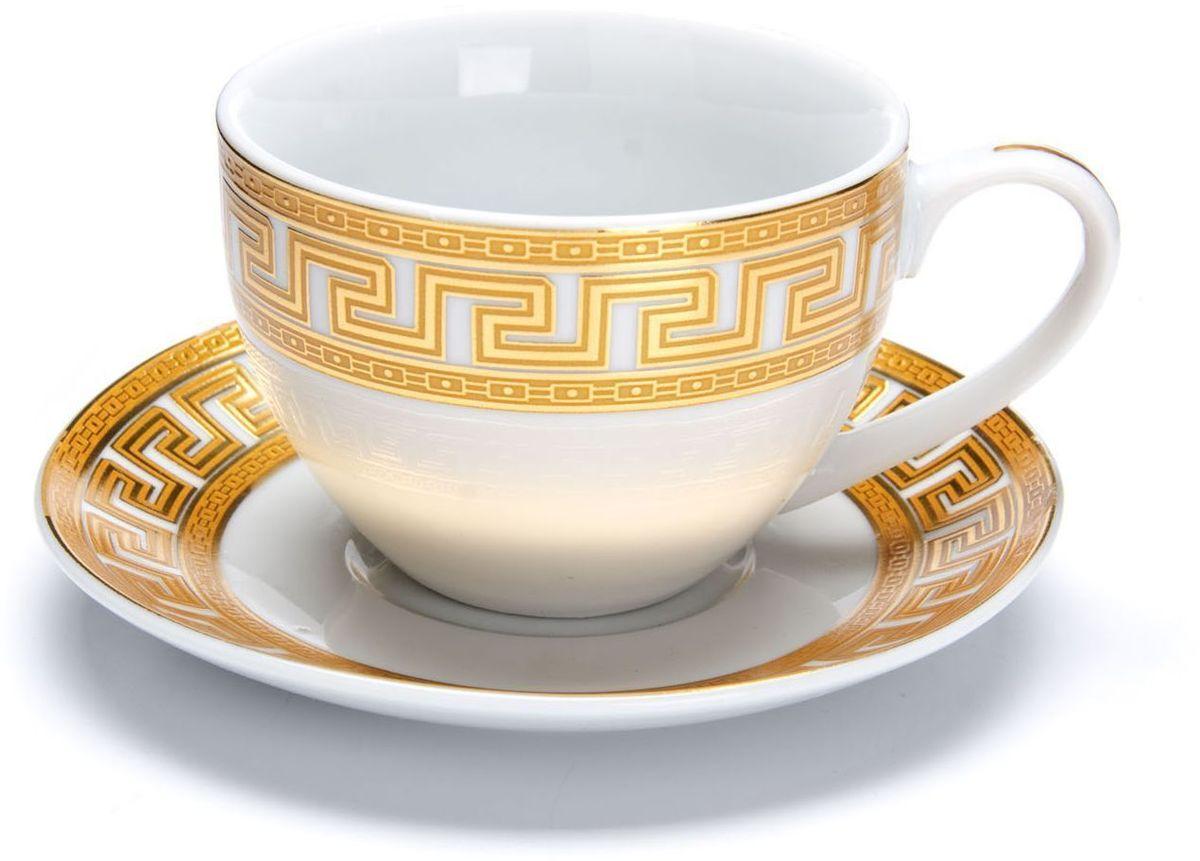Чайный сервиз Loraine Версаче, 12 предметов, 220 мл. 2642326423Чайный сервиз Loraine на 6 персон выполнен из высококачественной керамики белого цвета и украшен широким золотым орнаментом в греческом стиле. Изящный дизайн придется по вкусу и ценителям классики, и тем, кто предпочитает утонченность и изысканность.Сервиз упакован в круглую подарочную коробку. Каждый предмет надежно зафиксирован внутри коробки благодаря специальным выемкам.Элегантный и стильный чайный сервиз не только украсит сервировку стола, но и поднимет настроение и превратит процесс чаепития в одно удовольствие.Чайный сервиз - идеальный и необходимый подарок для вашего дома и для ваших друзей в праздники, юбилеи и торжества!В наборе 6 чашек и 6 блюдец.Диаметр чашки: 9 см.Высота чашки: 6,5 см.Объем чашки: 220 мл.Диаметр блюдца: 13,5 см