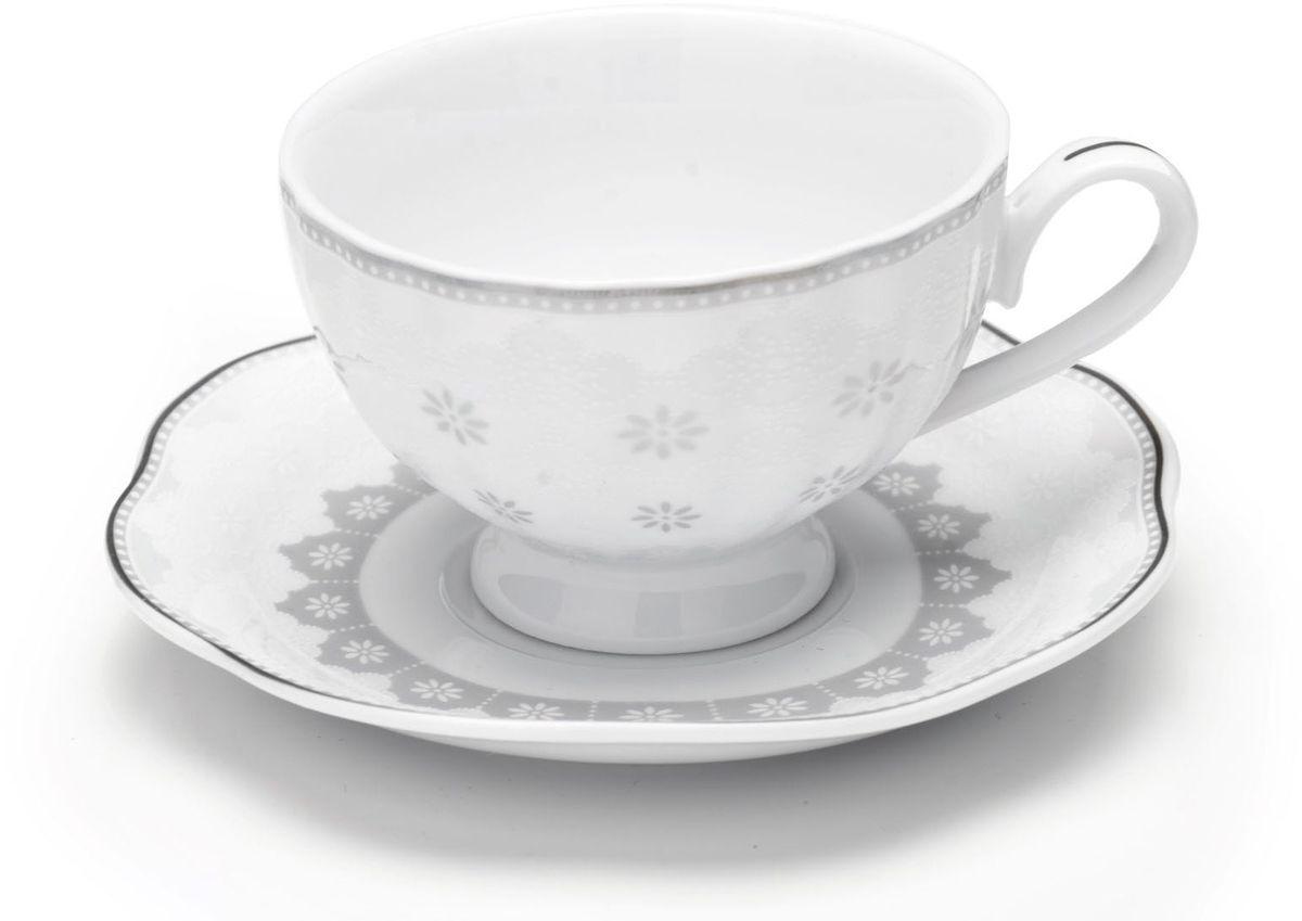 Кофейный сервиз Loraine, цвет: серый, 110 мл, 12 предметов. 2644126441Кофейный набор на 6 персон Loraine выполнен из высококачественного костяного фарфора - материала безопасного для здоровья и надолго сохраняющего тепло напитка. В наборе 6 кофейных чашек и 6 блюдец. Несмотря на свою внешнюю хрупкость, каждый из предметов набора обладает высокой прочностью и надежностью.Элегантный классический дизайн с тонкой золотой каймой делает этот кофейный набор прекрасным украшением любого стола.Набор аккуратно упакован в подарочную упаковку, поэтому его можно преподнести в качестве оригинального и практичного подарка для своих родных и самых близких.Подходит для мытья в посудомоечной машине.