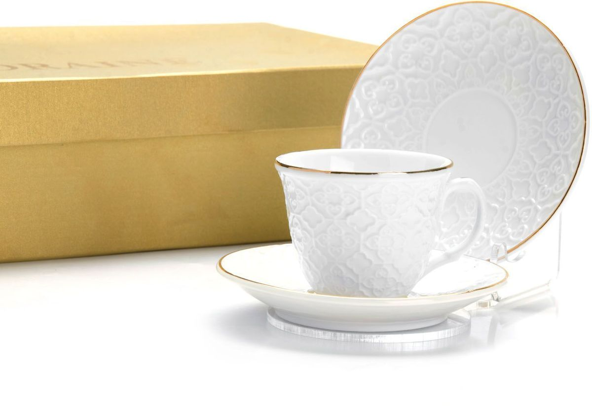 """Кофейный набор на 6 персон """"Loraine"""" выполнен из высококачественного костяного фарфора - материала безопасного для здоровья и надолго сохраняющего тепло напитка. В наборе 6 кофейных чашек и 6 блюдец. Несмотря на свою внешнюю хрупкость, каждый из предметов набора обладает высокой прочностью и надежностью.  Элегантный классический дизайн с тонкой золотой каймой делает этот кофейный набор прекрасным украшением любого стола.  Набор аккуратно упакован в подарочную упаковку, поэтому его можно преподнести в качестве оригинального и практичного подарка для своих родных и самых близких.  Подходит для мытья в посудомоечной машине."""