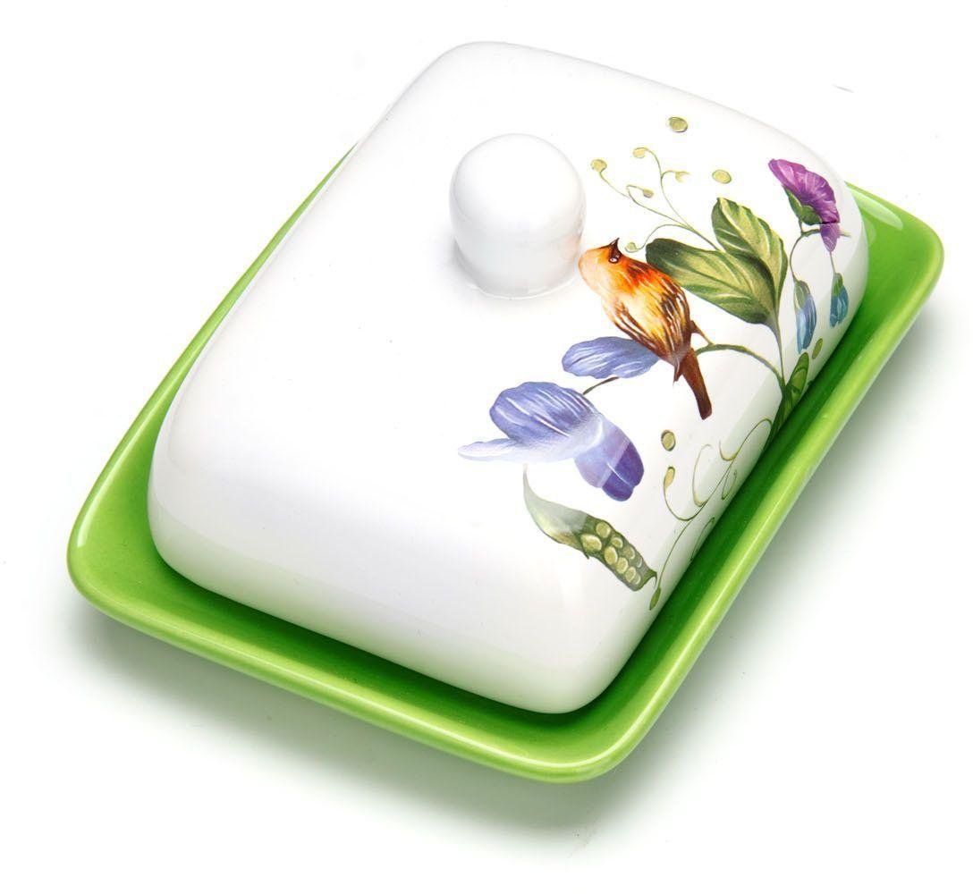 """Масленка """"Loraine"""", выполненная из качественной доломитовой керамики и декорированная ярким рисунком, станет украшением интерьера вашей кухни. Масленка надежно закрывается керамической крышкой и прекрасно подойдет для хранения и сервировки масла, сыра, творога.  Масленка рассчитана примерно на 200 грамм масла.  Пригодна для использования в холодильнике, морозильнике, микроволновой печи.  Подходит для мытья в посудомоечной машине. Размер блюда: 17 х 12,5 х 2,3 см.Размер крышки: 14 х 10 х 7,5 см.Общий размер масленки: 17 х 18,5 х 8,5 см."""